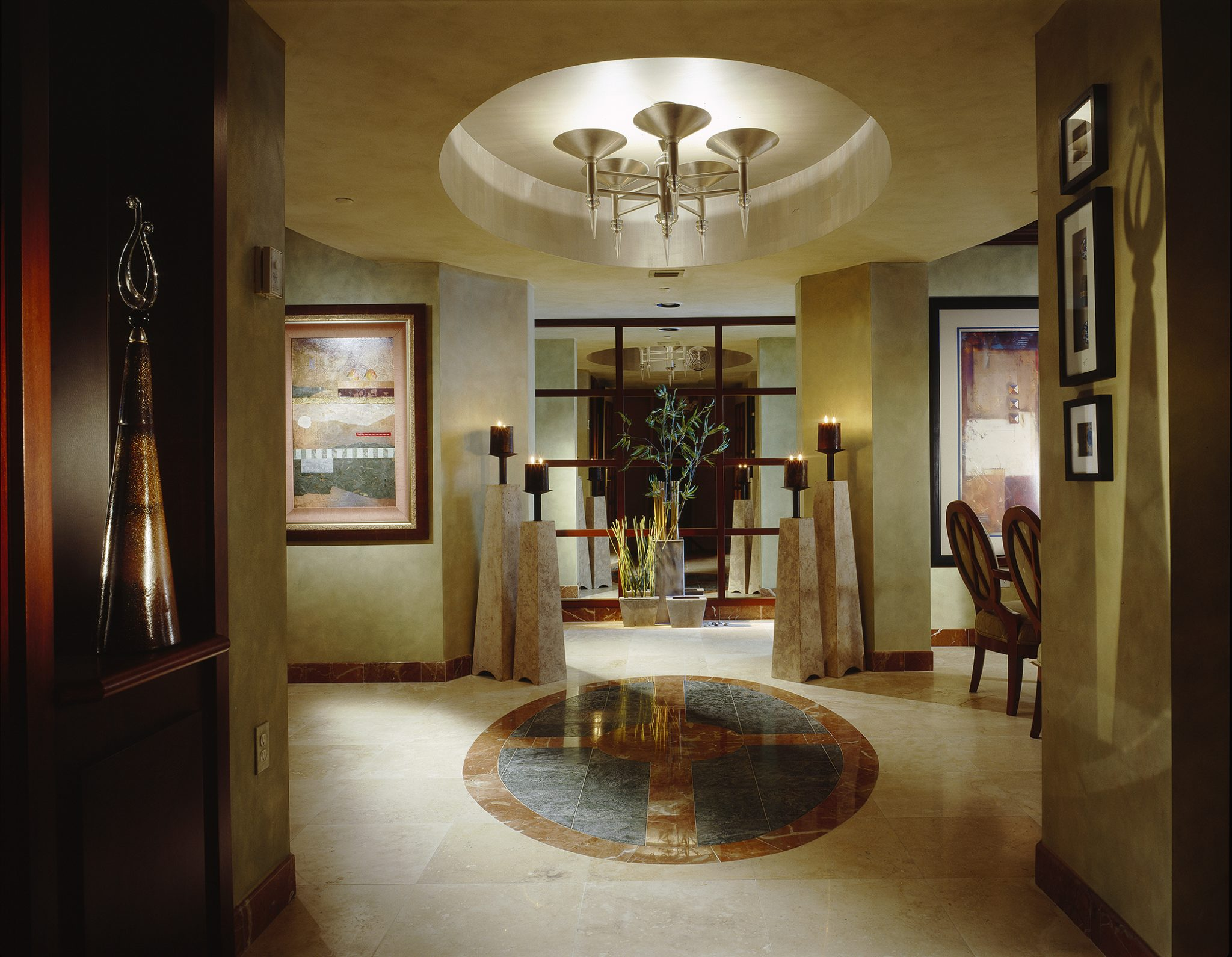 CITY MODERN Foyer features symmetrical styling. by Perla Lichi Design