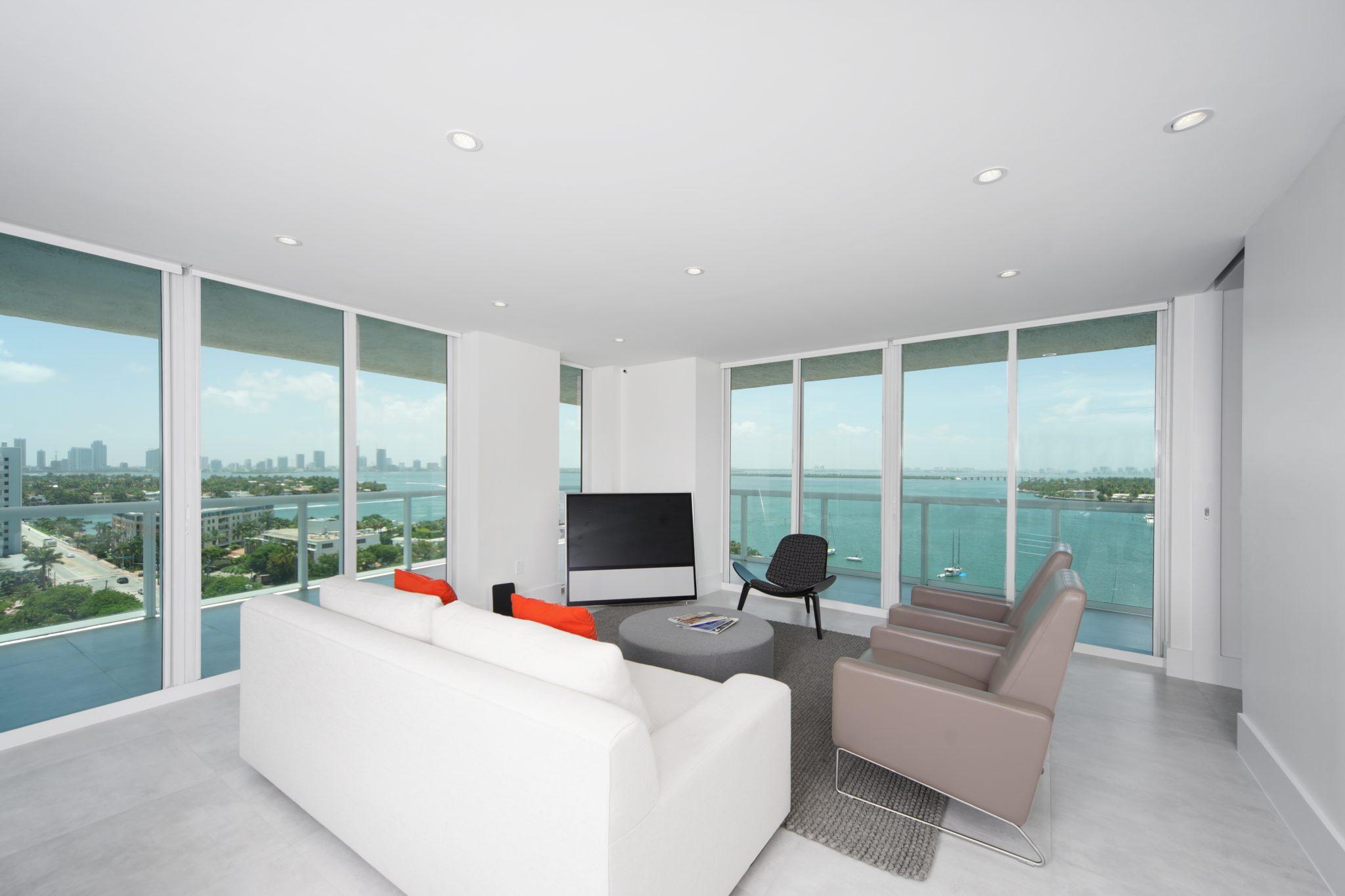 Venetian Islands Condominium Living Room with Wraparound Balcony by DiMare Design