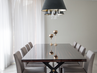 An elegant and minimalist high gloss ebony dining table with brass details. by Annette Frommer Interior Design