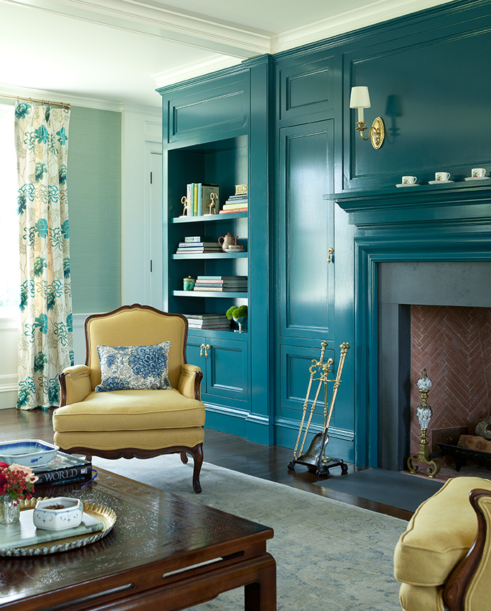 """Benjamin Moore Dark Teal (#2053-20)  """"We love this shade of teal as it transitions with the seasons and adds a much needed pop of color during the winter months. This color looks beautiful in a gloss finish on woodwork and paneling and complements traditional autumnal colors like orange, yellow, and cranberry. It creates a dramatic backdrop to highlight the details of crystal lighting and rich wood furniture and is welcoming to guests. Perfect for a country home.""""  Ariella Duker & Anelle Gandelman, of A-List Interiors"""