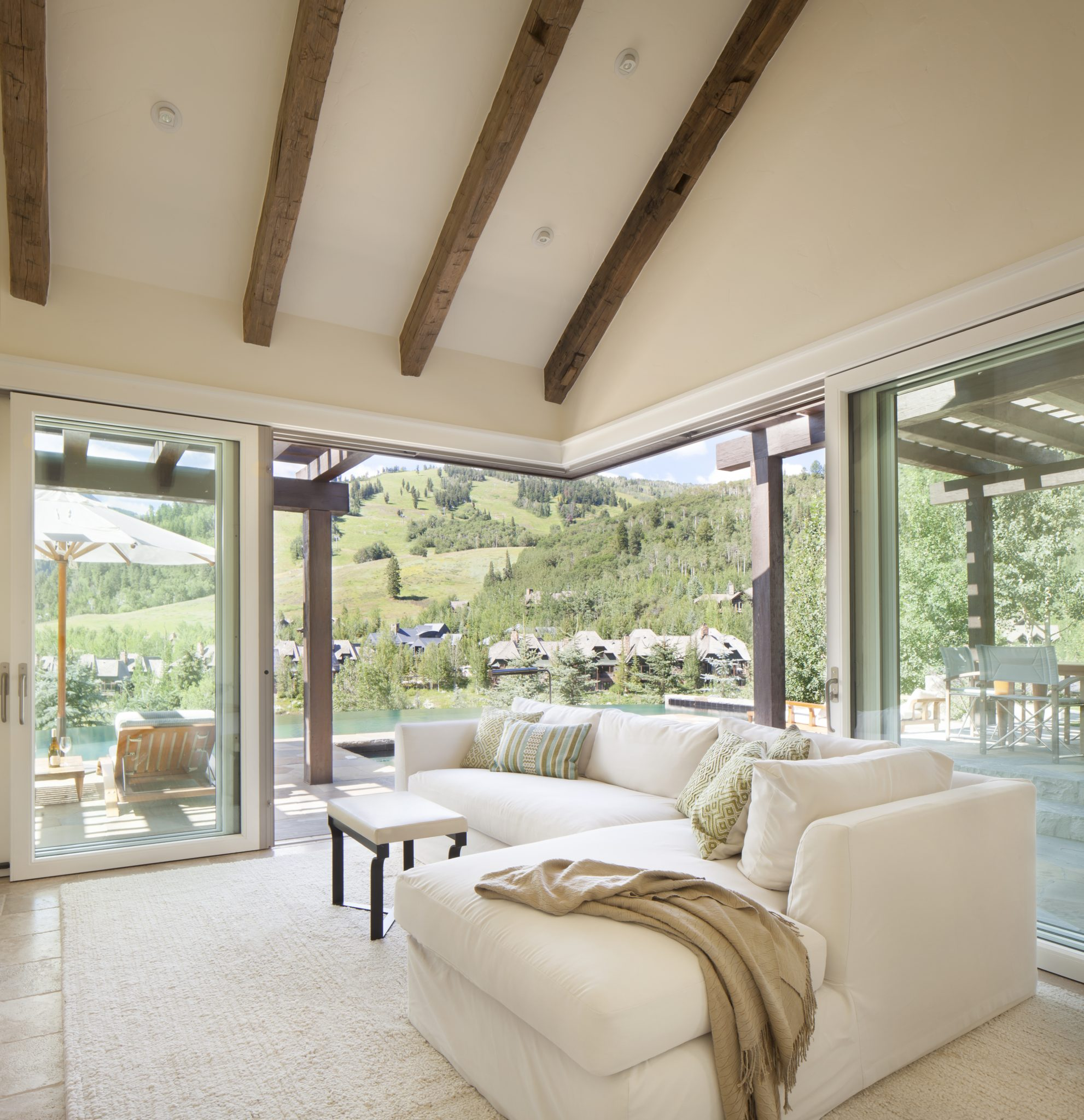 Large sliding glass doors brings the outside in by Brewster McLeod Architects