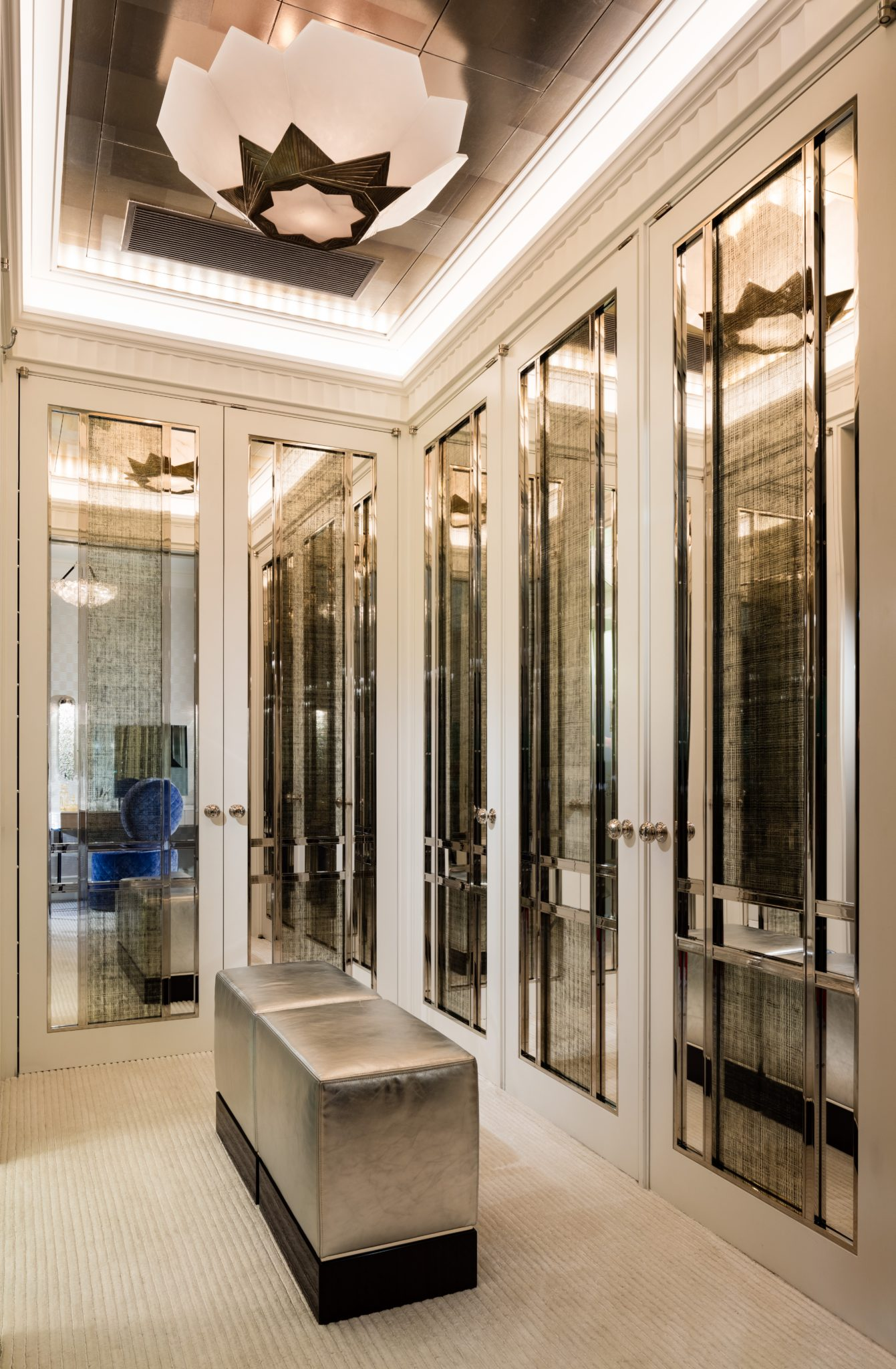 Luxurious dressing room designed for elegance and style. by Linda London Ltd.