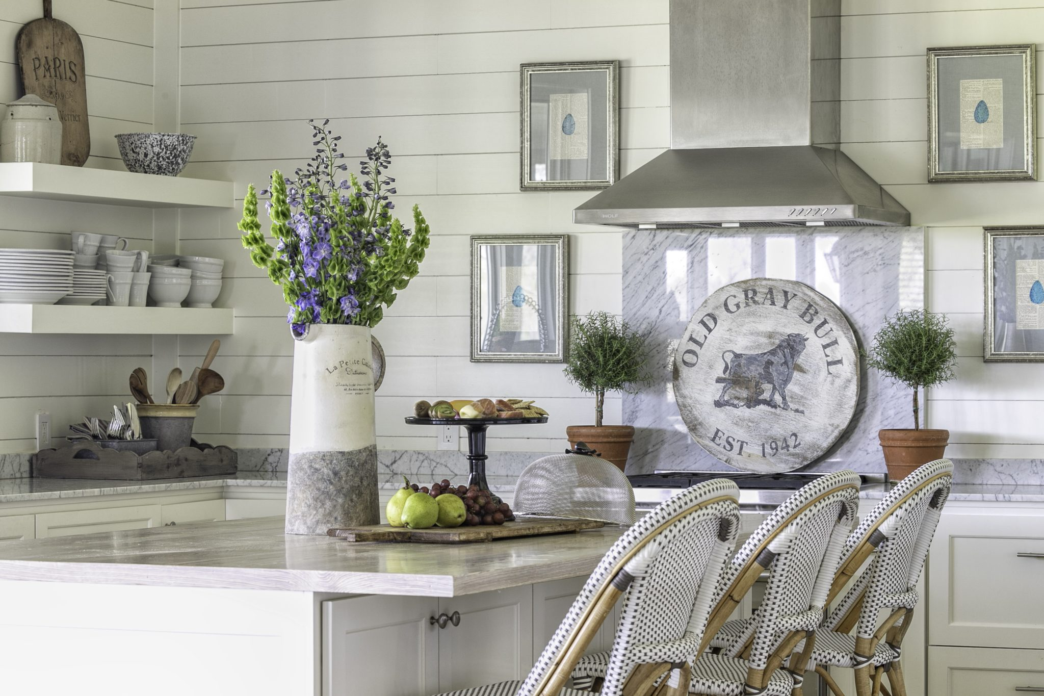 Texas farmhouse kitchen with shiplap walls & woven rattan counter stools by Cindy Witmer Designs