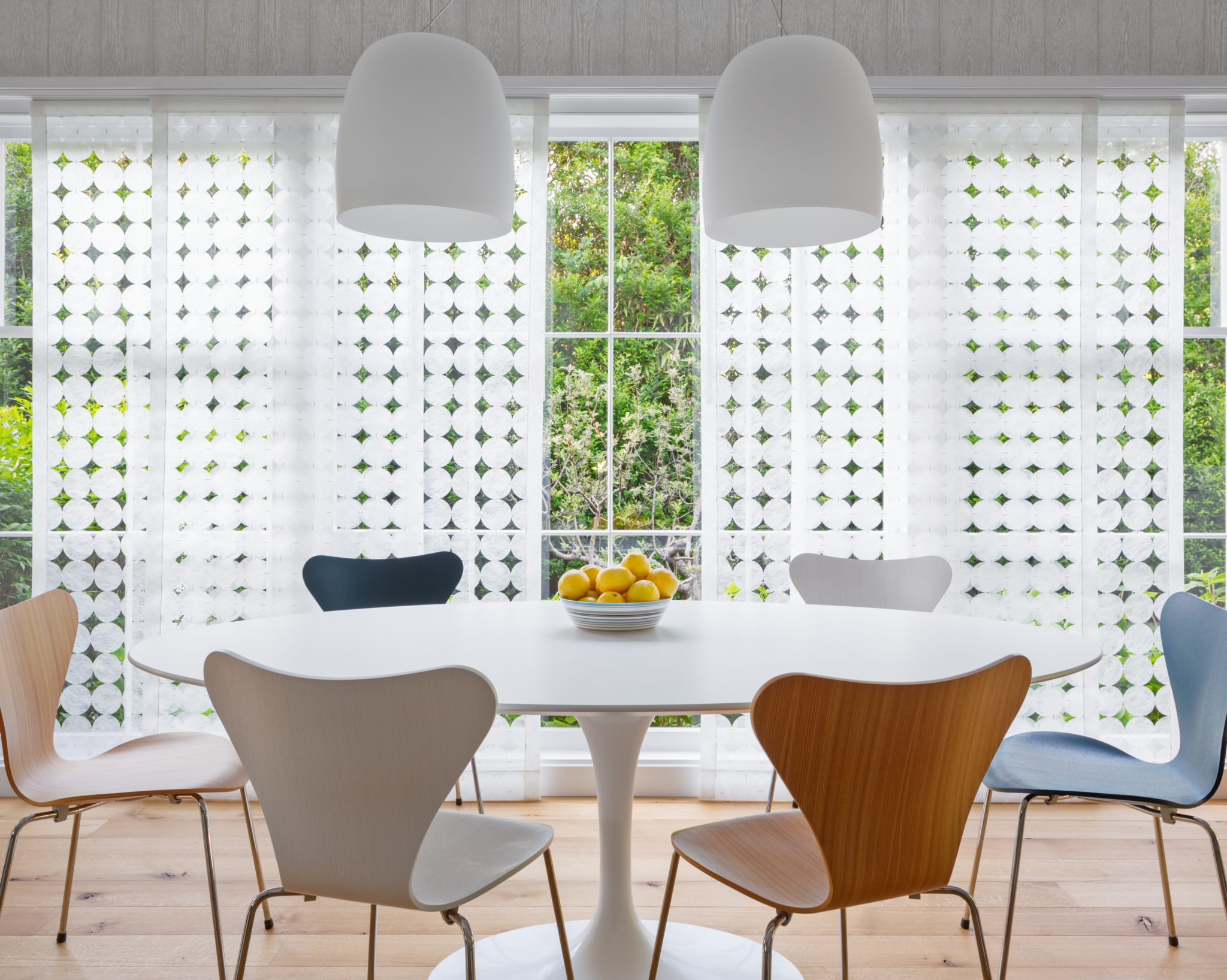 Dining room with large window and sliding window shades by Kellie Franklin