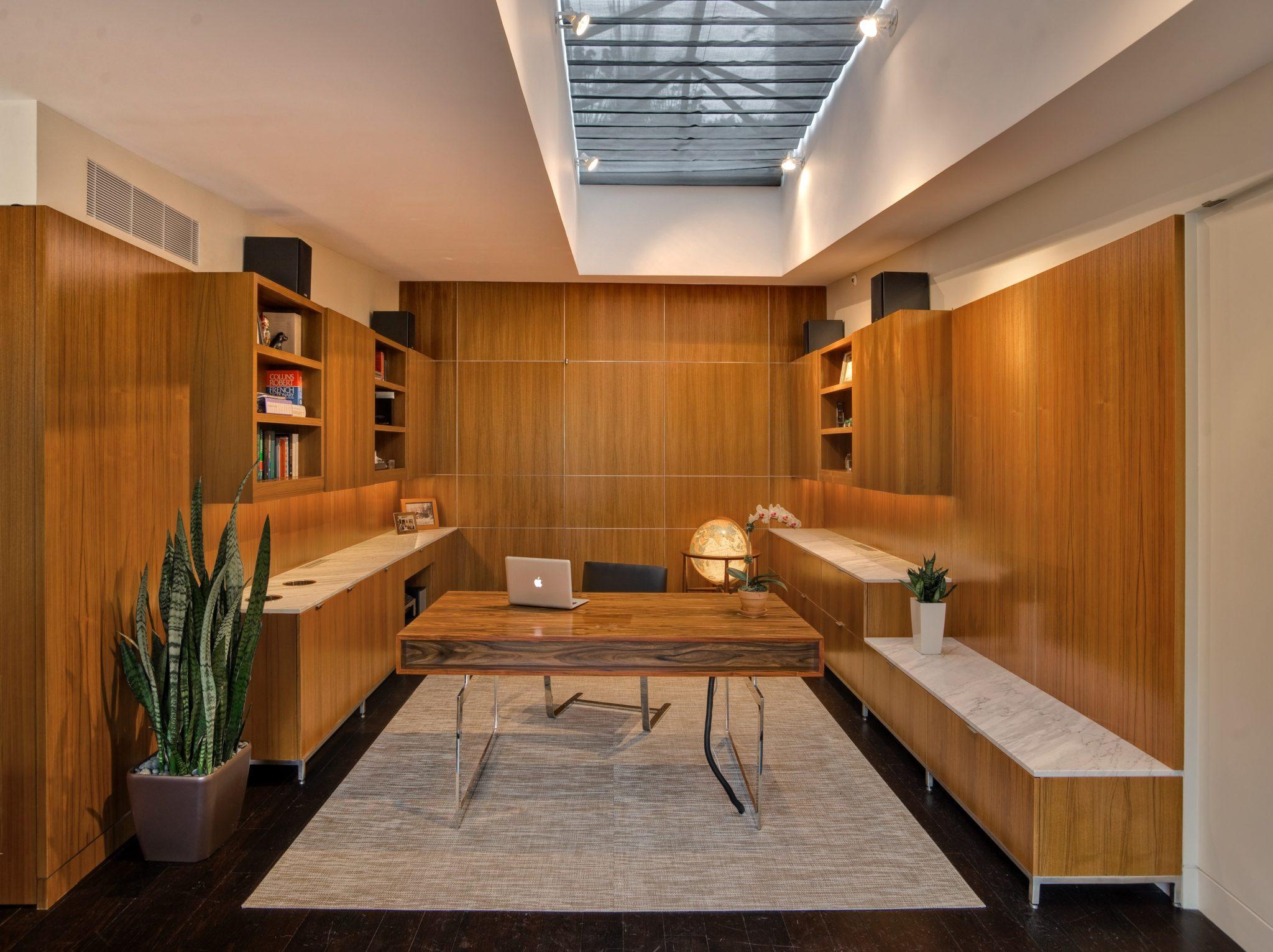 Modern Tribeca Loft, Paneled wood intimate Library by Jennifer Tulley Architects