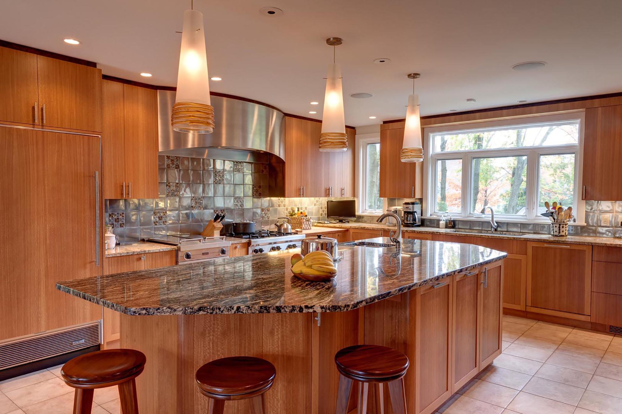 Totally custom kitchen with three different woods and two counter top materials by Susan Dearborn Interiors Inc.