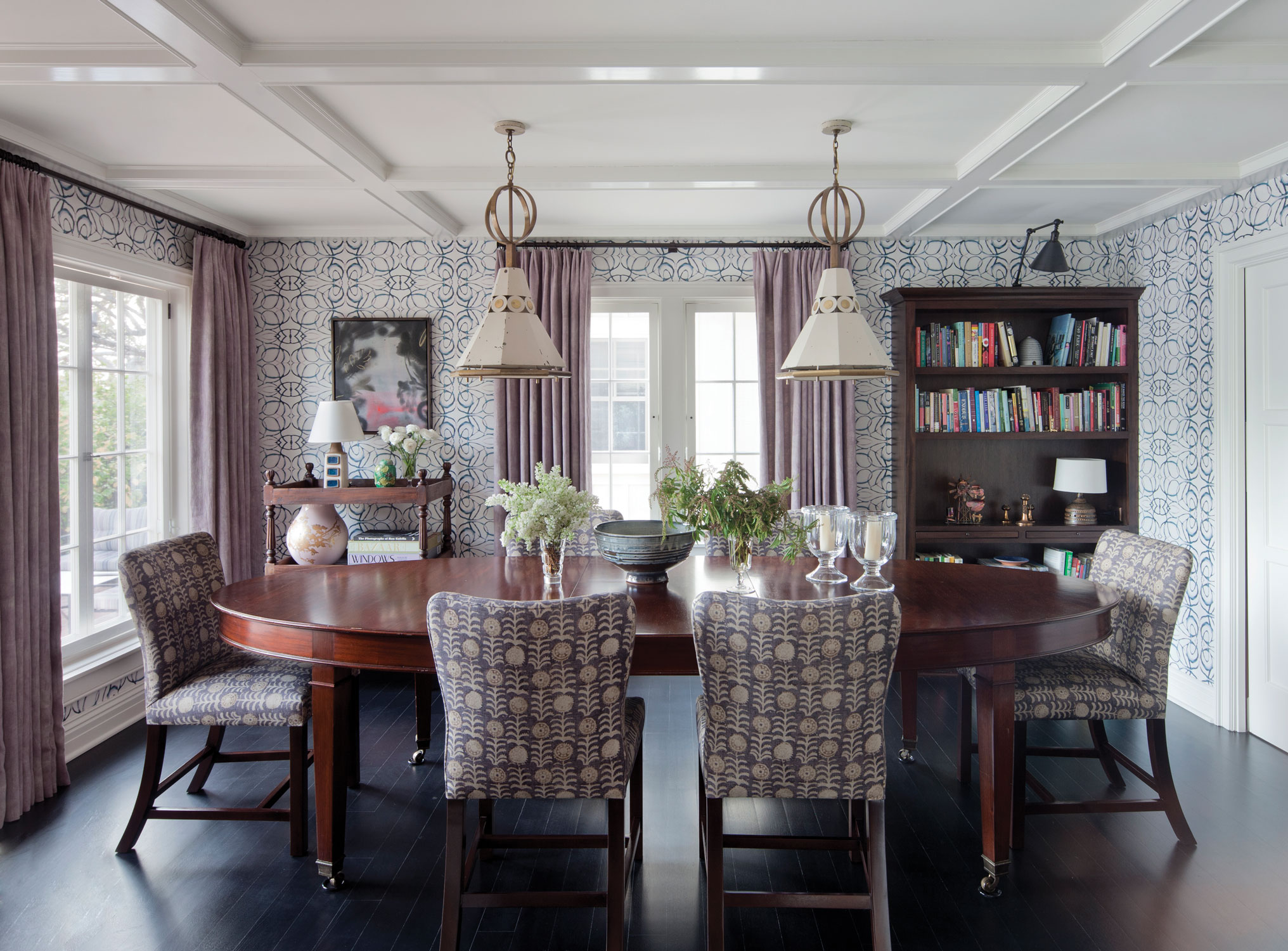 Dining room with coffered ceiling by Tim Barber Ltd.