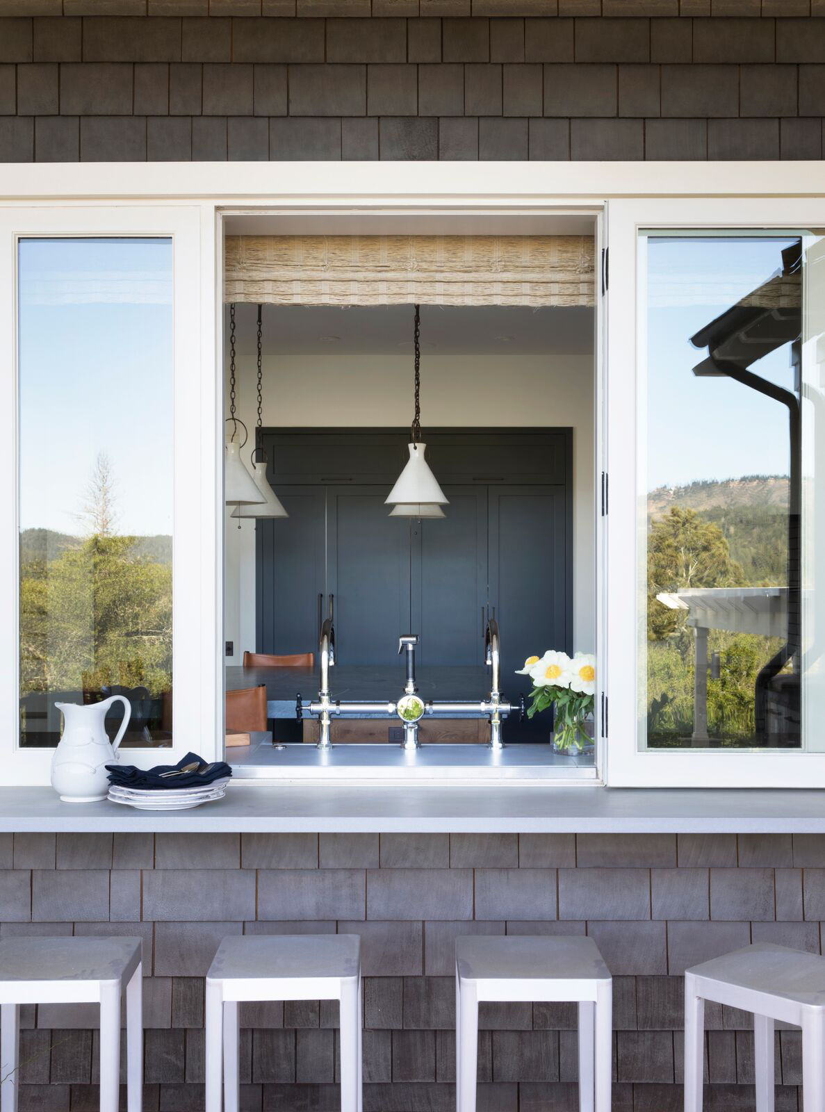 "Kitchen Window Pass-Throughs  ""Celebrating the best of indoor/outdoor living, kitchen window pass-throughs are a terrific way to connect outside entertaining spaces, especially when direct door access is limited. Form meets function in a beautiful way."" — Ani Wade, Wade Design Architects"