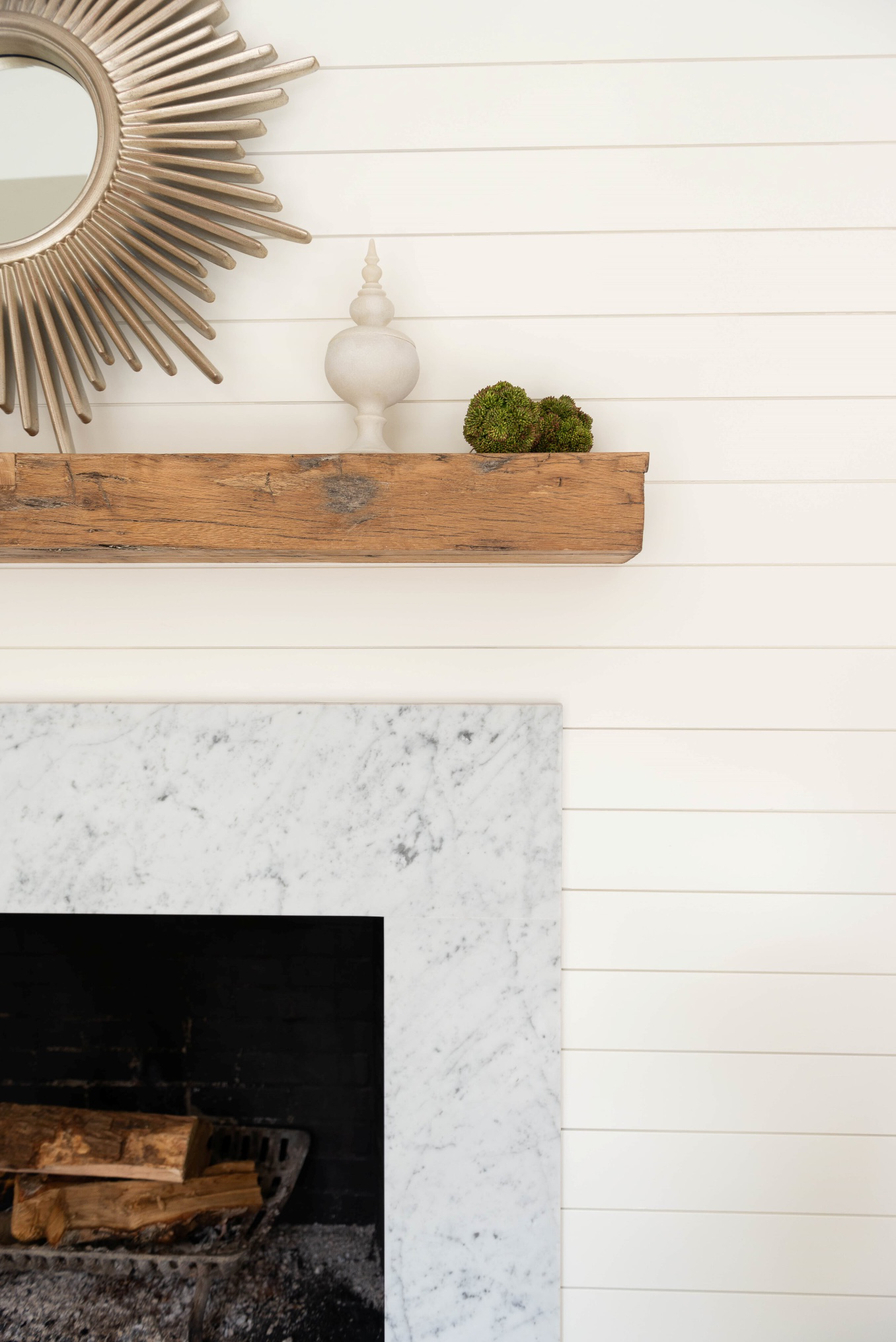 A mantle refresh with ship lap, new stone surround and antique beam by Fiona Leonard Interiors
