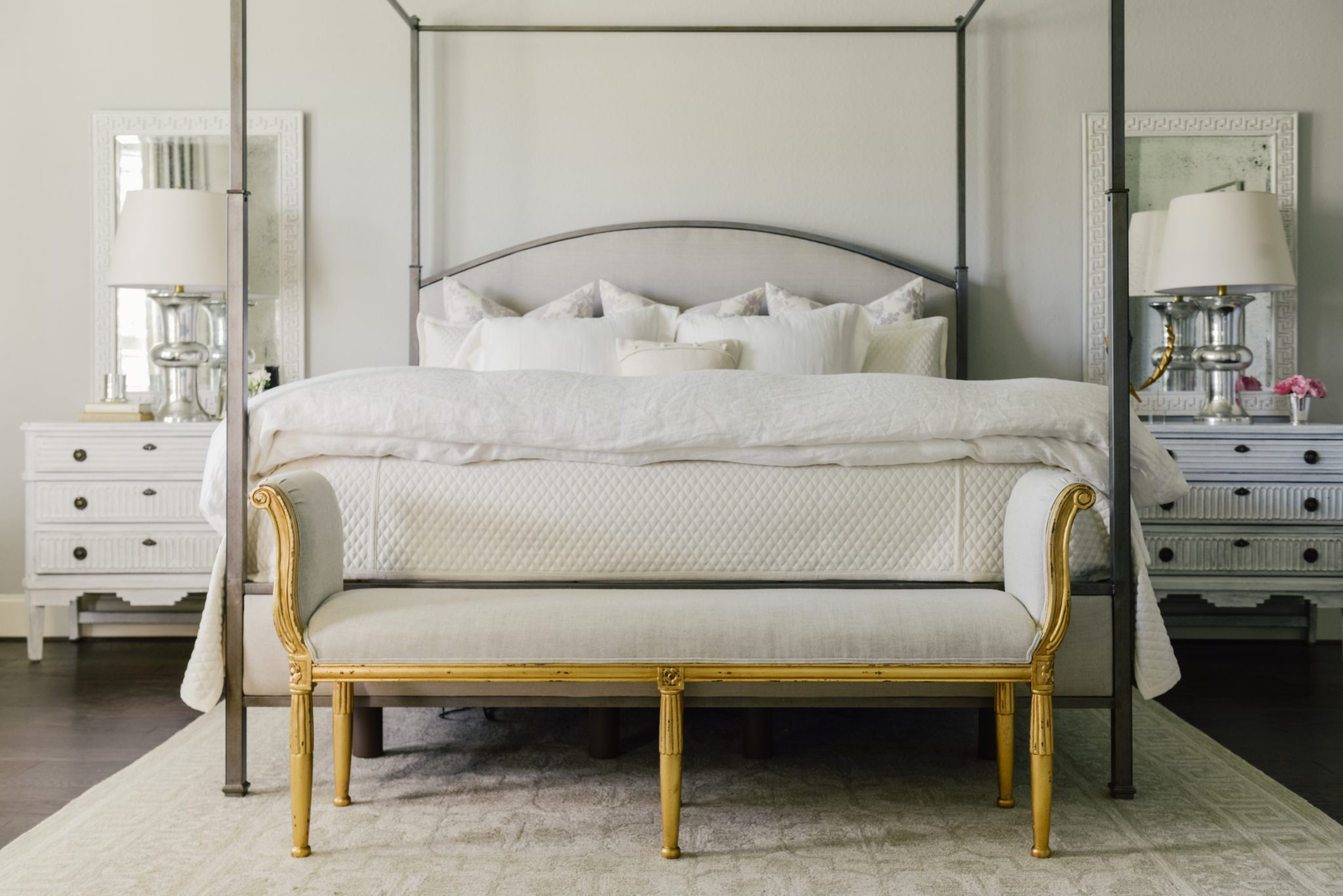 Houston Master Bedroom featuring Iron Canopy Bed and Neutral Palette by Paloma Contreras Design