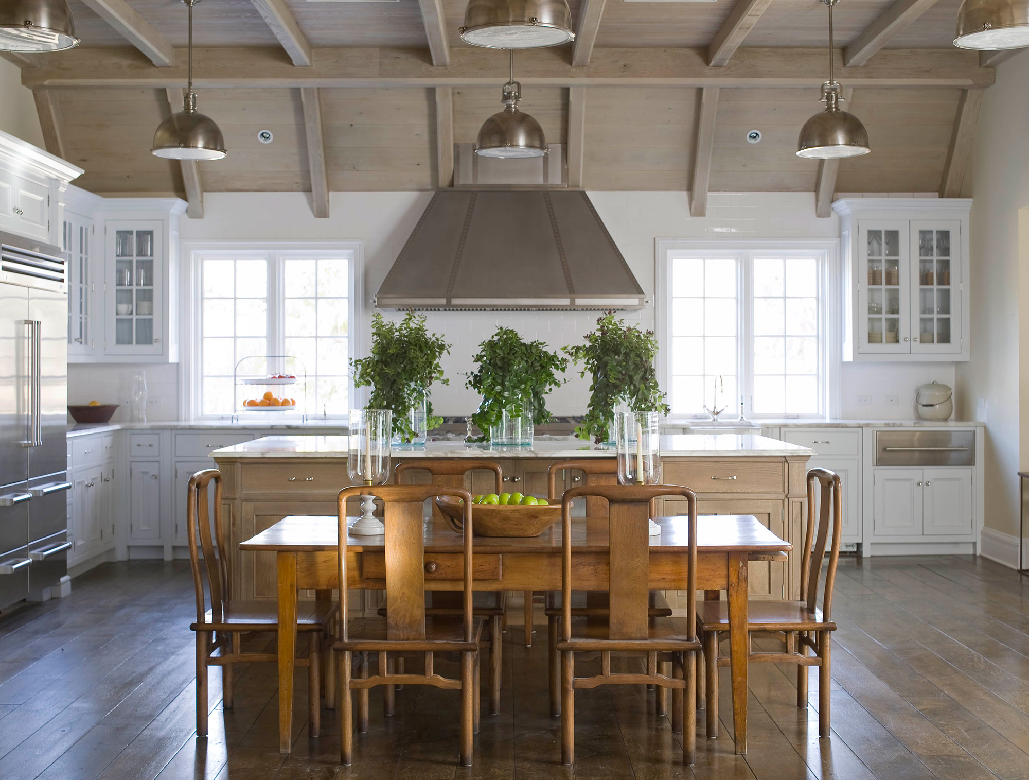 East Hampton kitchen with large island and stainless steel appliances by James Michael Howard