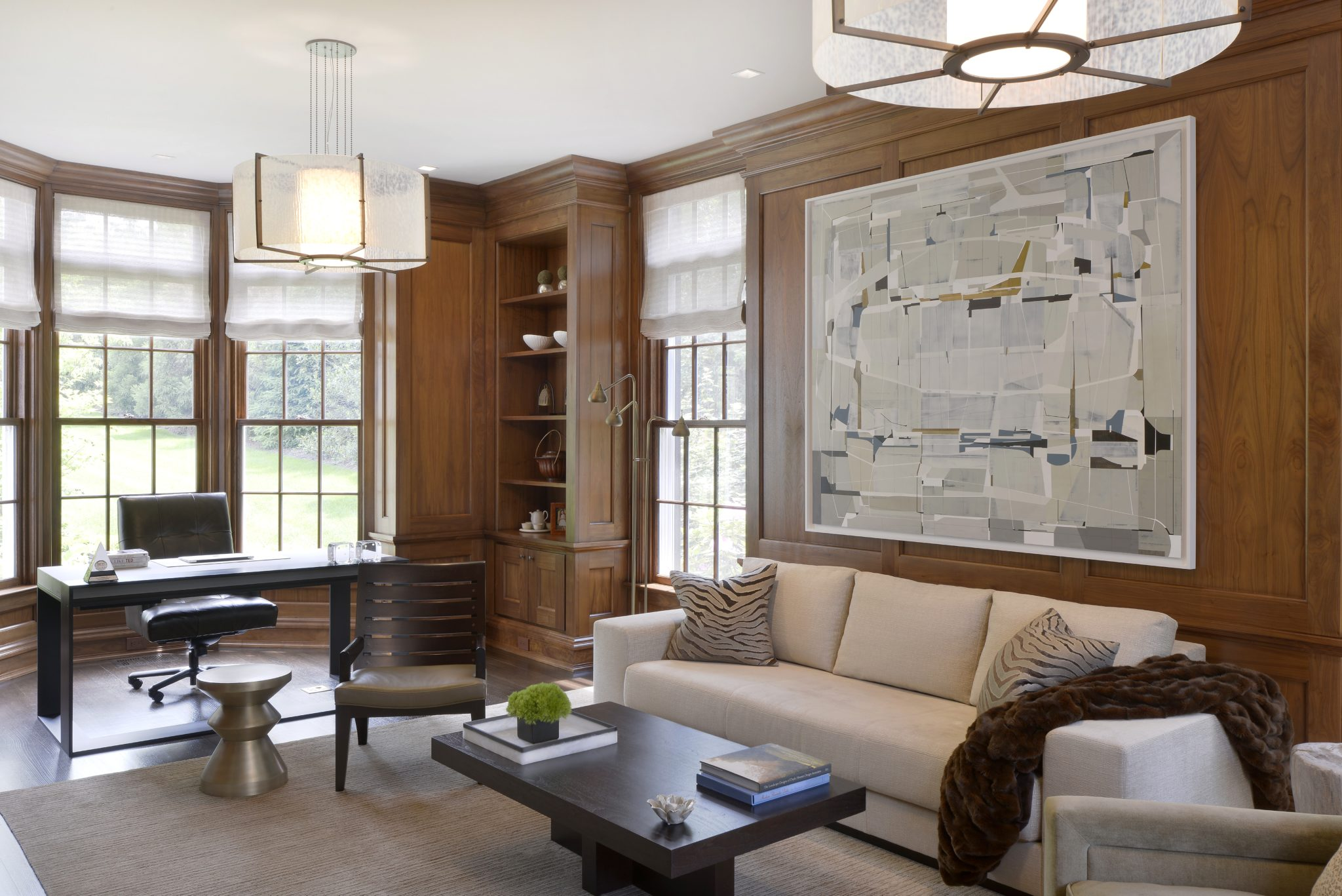 Living room with stain grade paneled walls by Alisberg Parker Architects