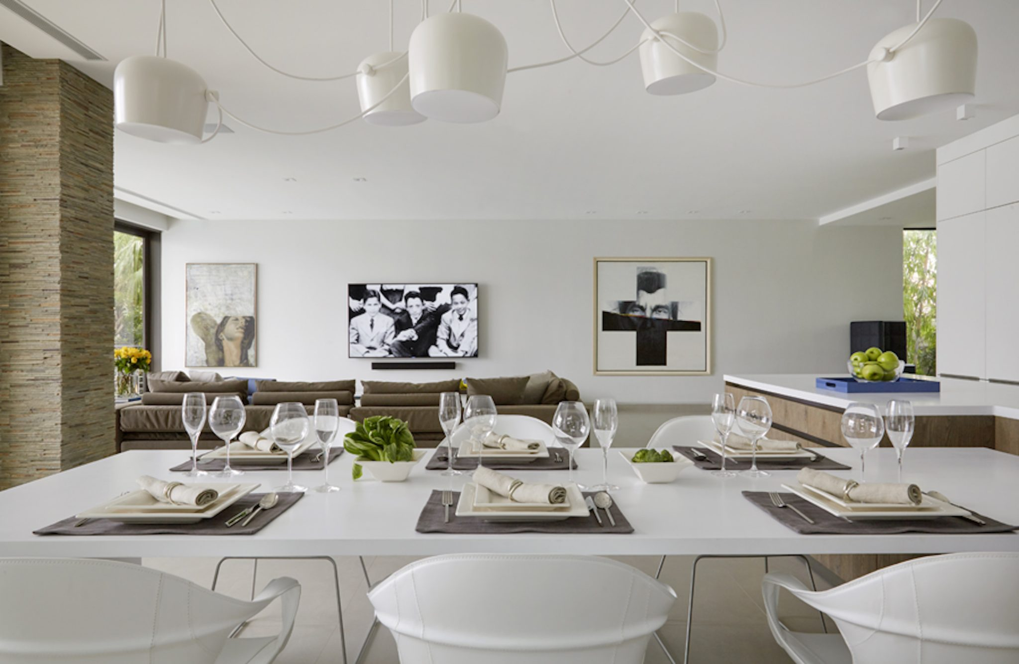 The free floating light fixture over the dining area injects a random order of whimsy. By Dunagan Diverio Design Group