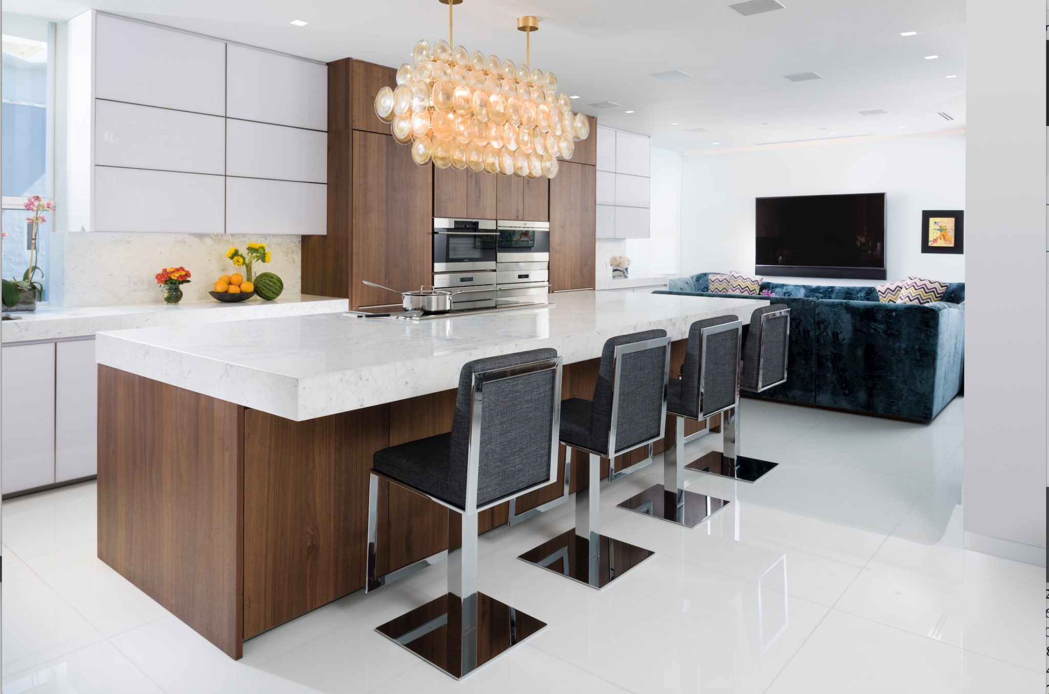 Penthouse oceanfront penthouse kitchen and family room by Brown Davis Interiors, Inc.