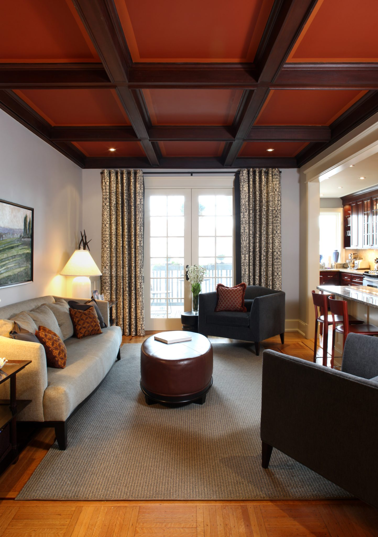 Family room with coffered ceiling in Washington, DC, rowhouse. By J.D. Ireland Interior Architecture & Design