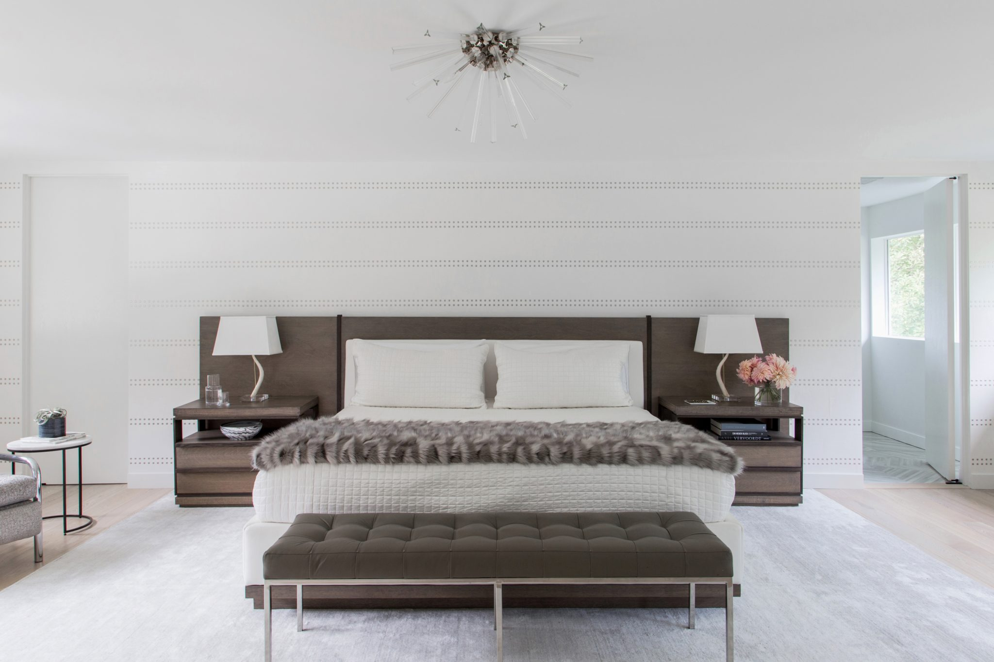 Gold Coast white bedroom with custom bed and burst light by Abaca Interiors