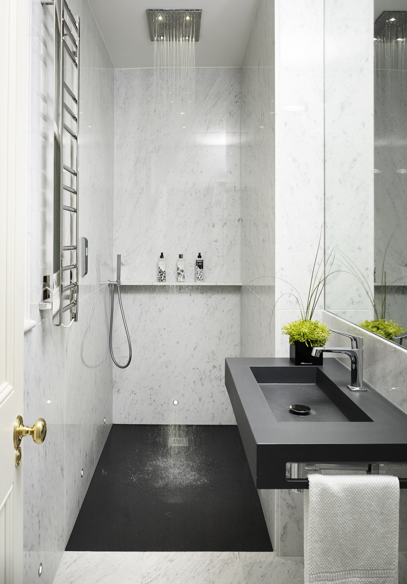 #3: Clean, masculine master bathroom with statuary marble and black corian in a pied-à-terre designed by The Olive Design Studio in London's Belgravia neighborhood.  See more of the home here>
