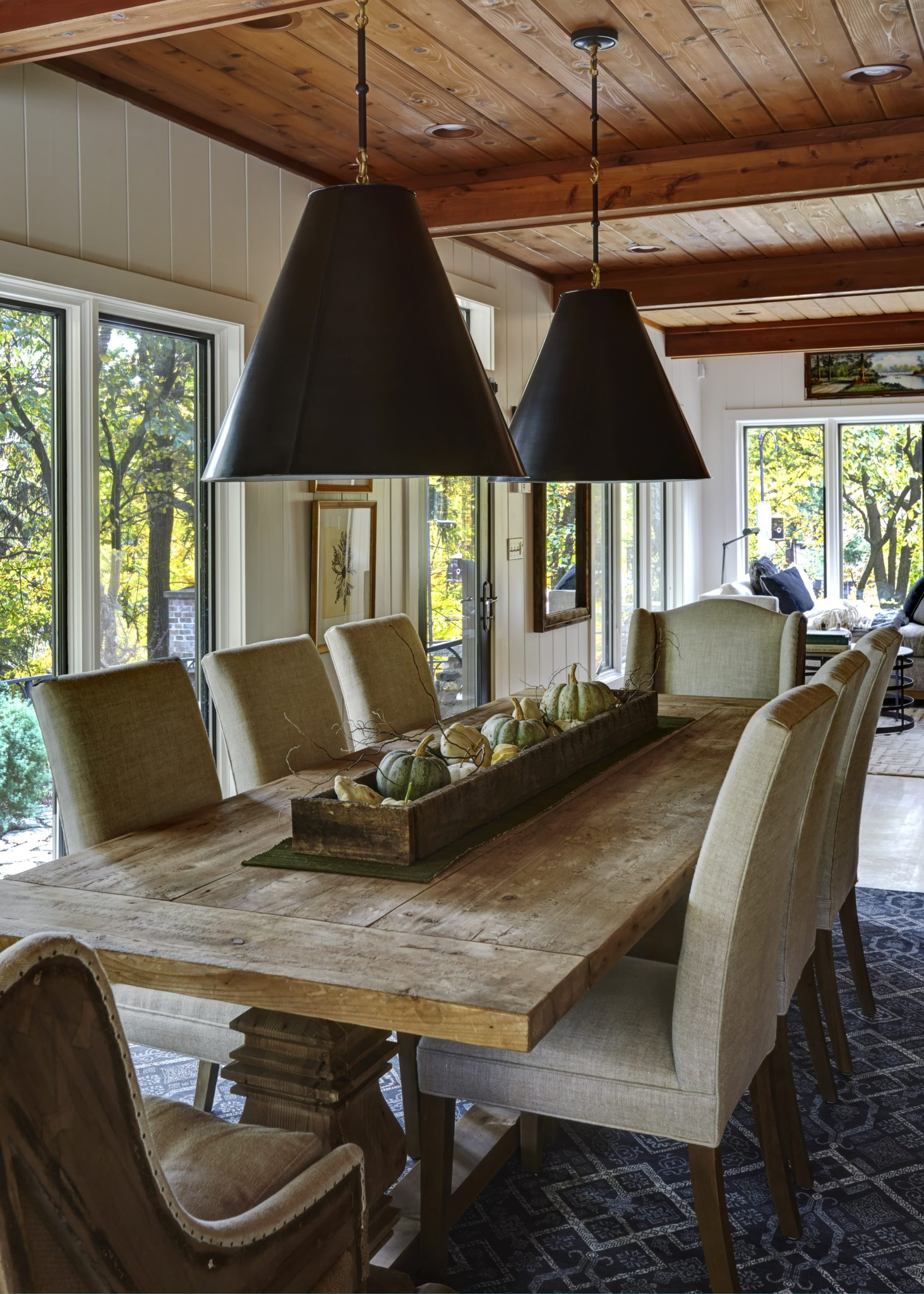 A pair of shaded light fixtures casts a soft glow over the trestle table. By Schlagenhaft Studio