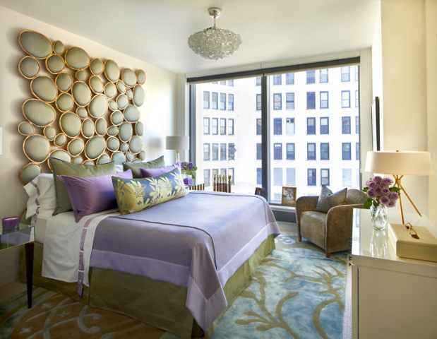 The crowning moment in this master suite is the dramatic headboard. by BJS Assoc Interior Design