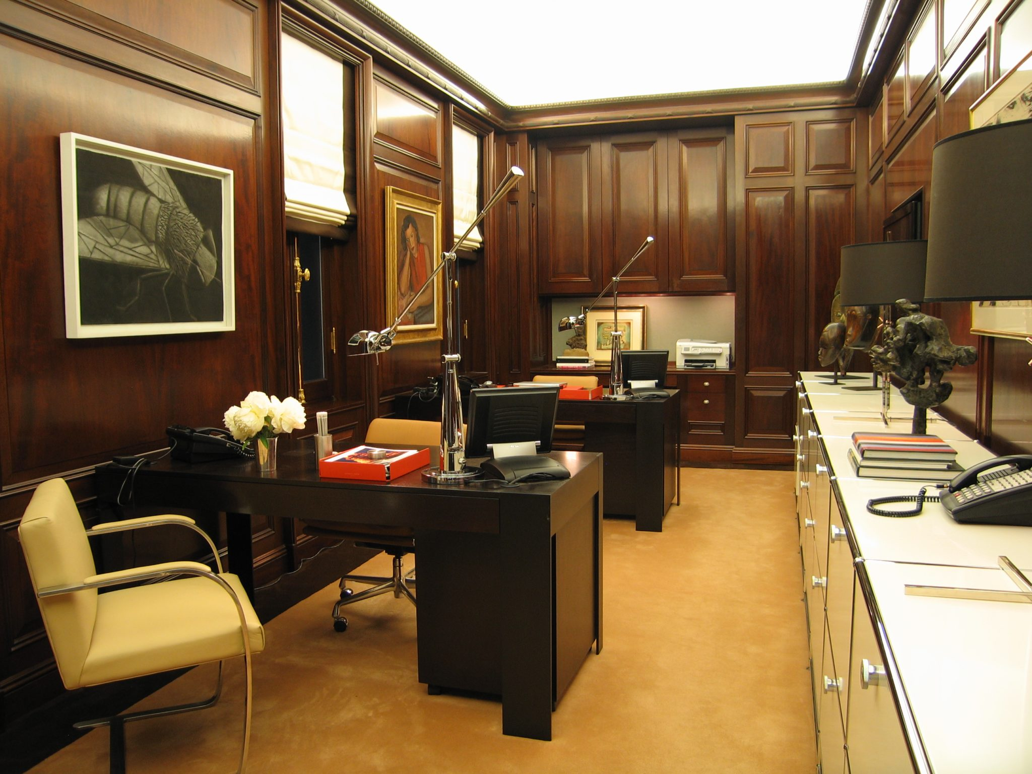 Wood-Paneled Home Office with Modern Fixtures by S.B. Long Interiors