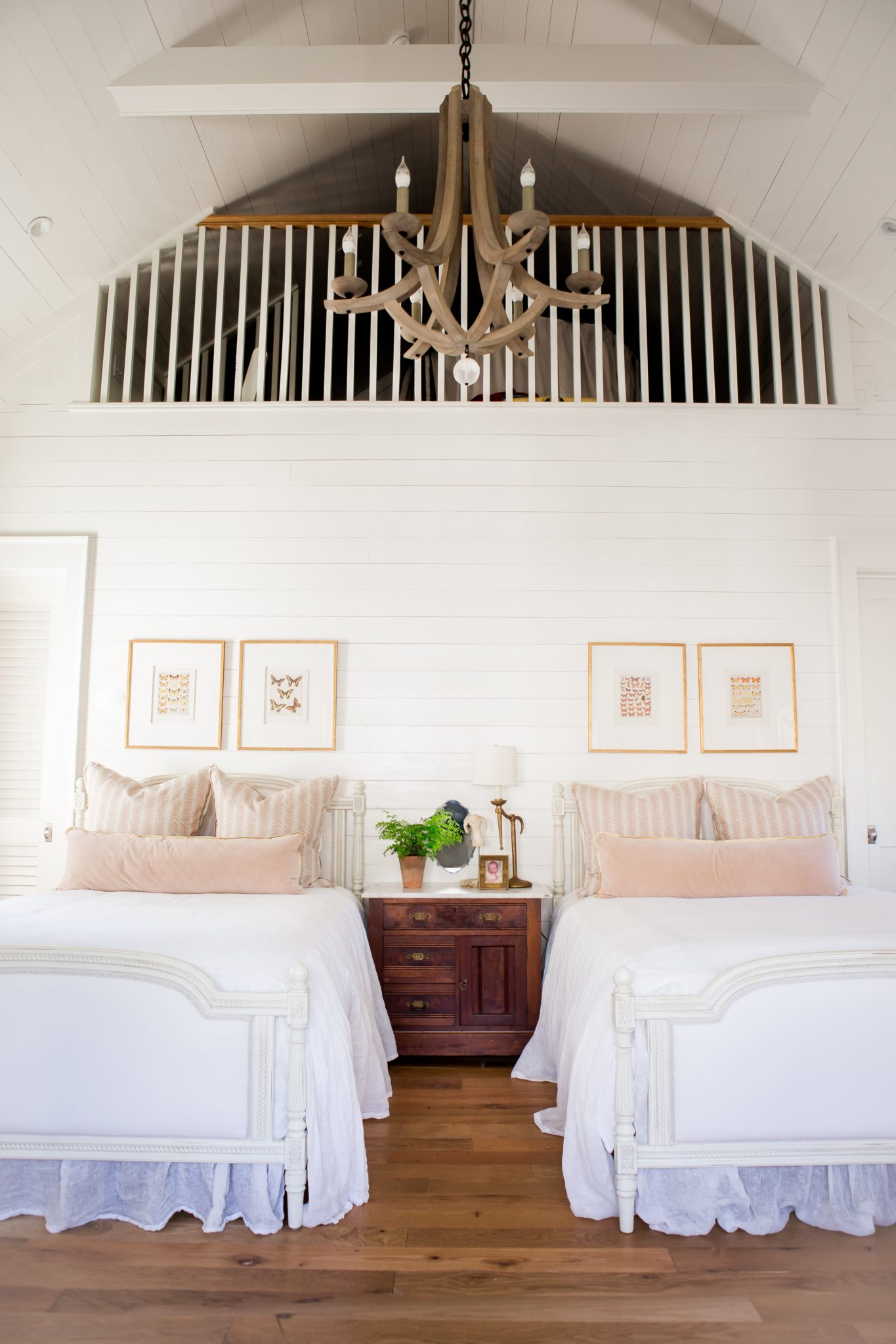 Florida beach house with loft, pink pillows & shiplap walls by Ashley Gilbreath Interior Design