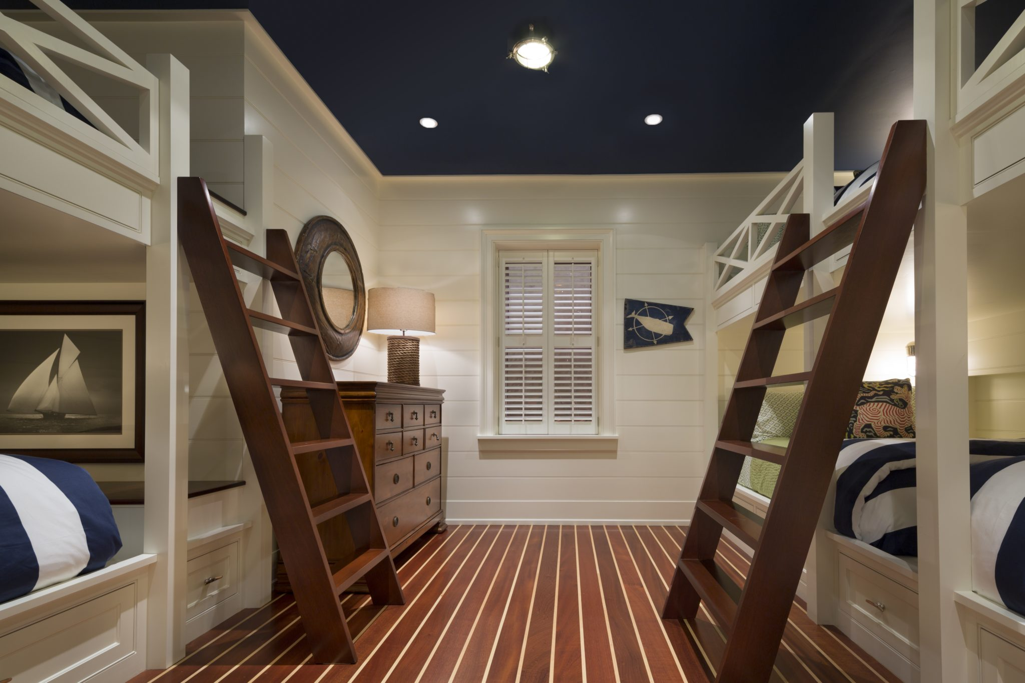 Nautical bedroom with built-in bunk beds, shiplap walls and navy blue ceiling by SLC Interiors