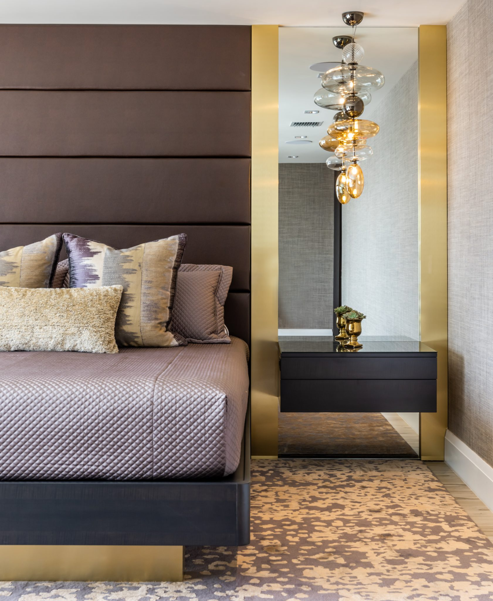Luxurious master bedroom with custom furniture and fixtures by Maritza Capiro Designs Corp.