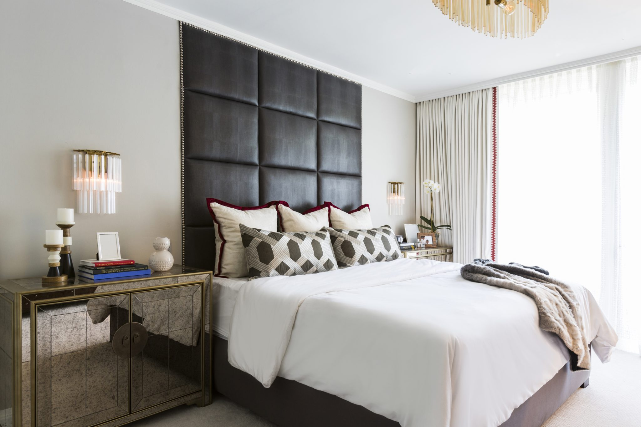 Over-sized headboard in 1950's home renovation by Laura U, Inc.