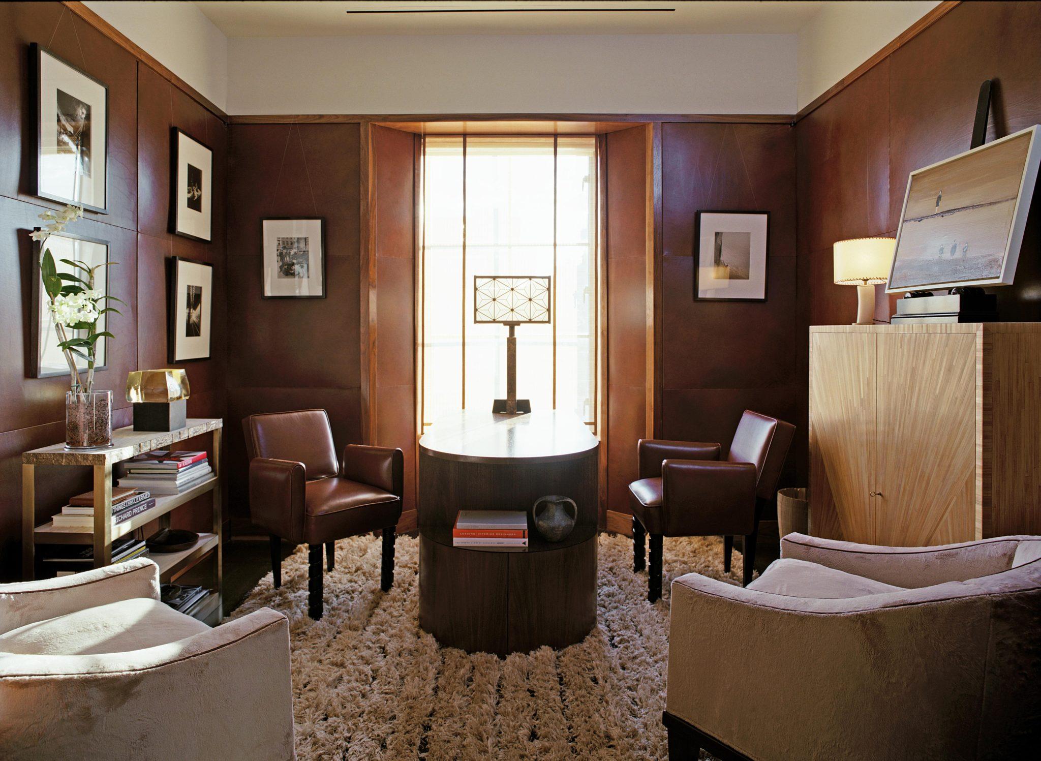Soho Loft Study with paneled walls by de la Torre design studio llc.