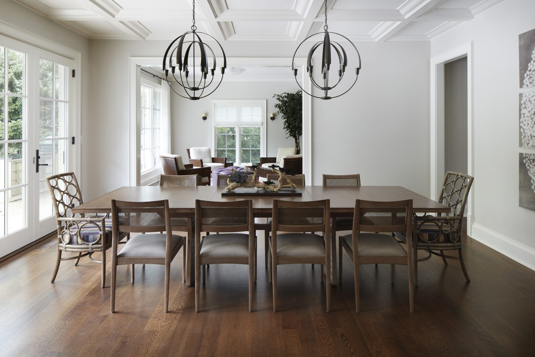 A coffered ceiling adds visual interest to this dining room by Morgante-Wilson