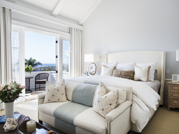 Master bedroom by the sea by DTM Interiors