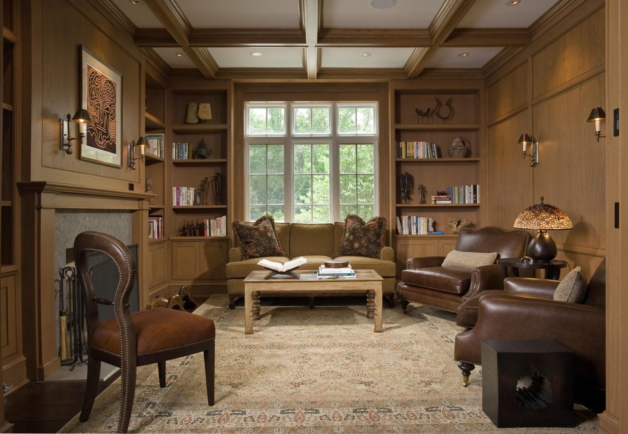 Wood Paneled Library with Fireplace by bba ARCHITECTS