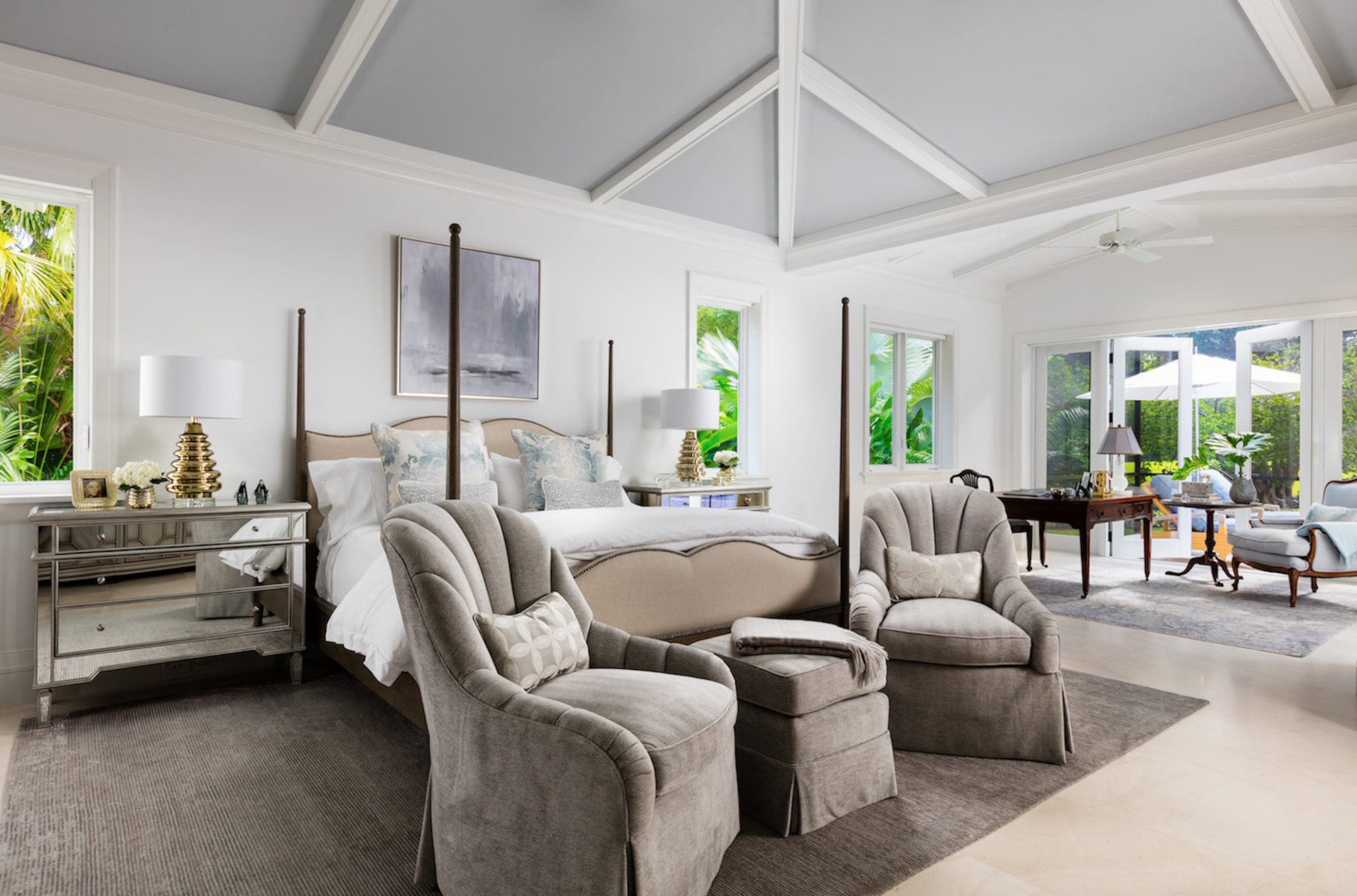 The master bedroom is an eccentric blend of British colonialism and Hollywood. by Gil Walsh Interiors