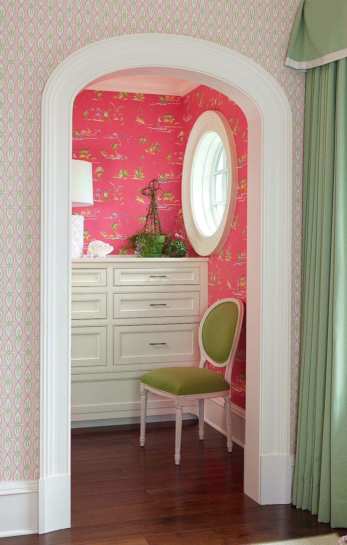 Serious Color in Dressing Room Alcove with Arched Cased Opening and Round Window by Island Architects