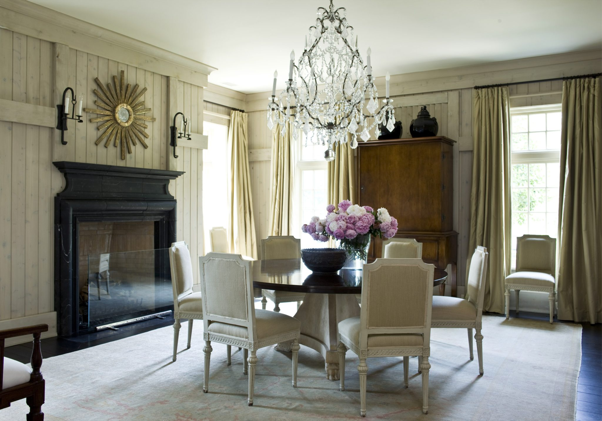 Authentic dining room with paneled walls by Suzanne Kasler Interiors