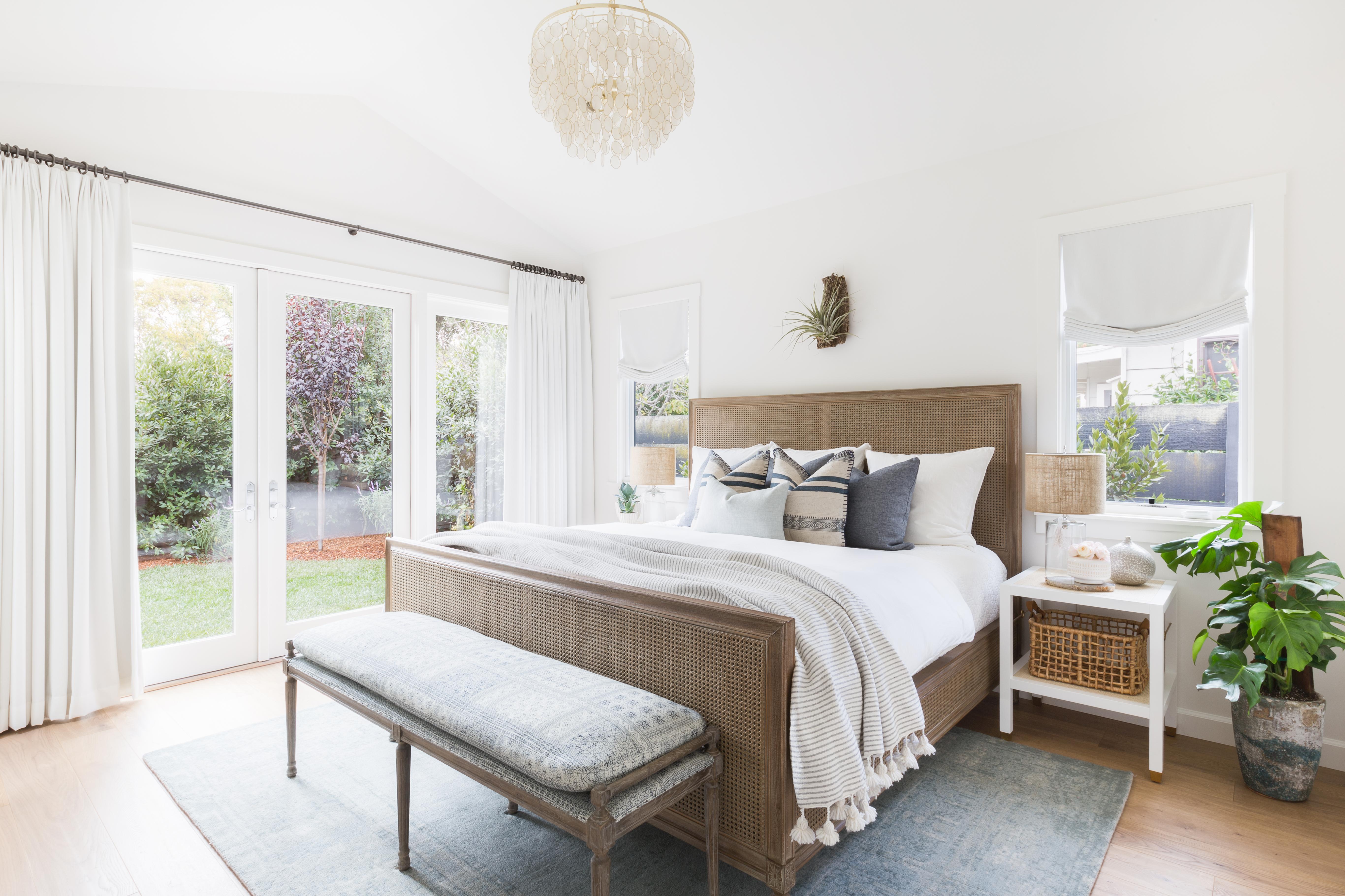Coastal and bohemian master bedroom by Amanda Barnes Interiors