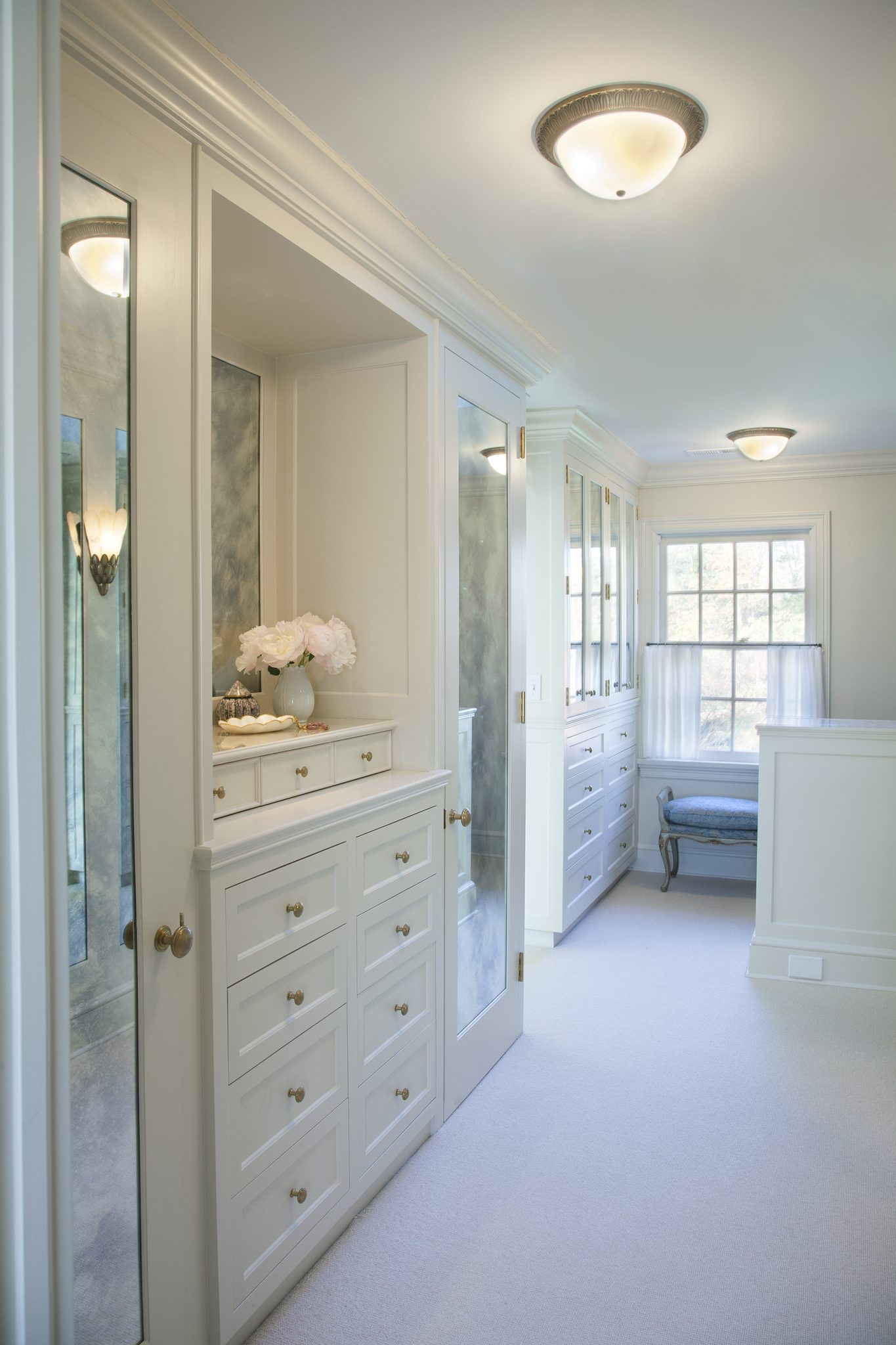 Master Dressing Room is outfitted with custom cabinetry by Liliane Hart Interiors