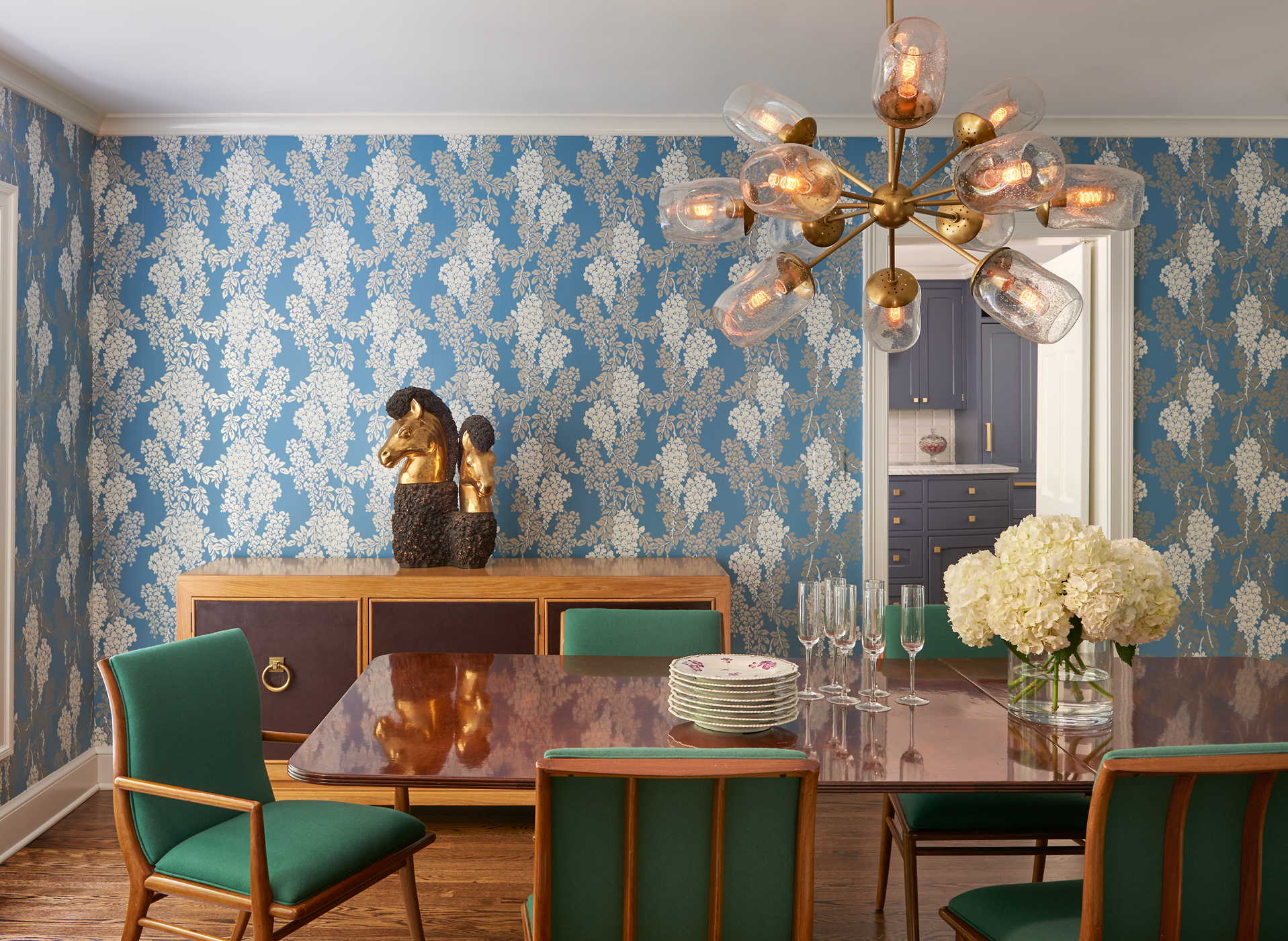 Washington, DC, dining room with vivid wallpaper and modern chandelier. Architecture by Barnes Vanze Architects, Inc.