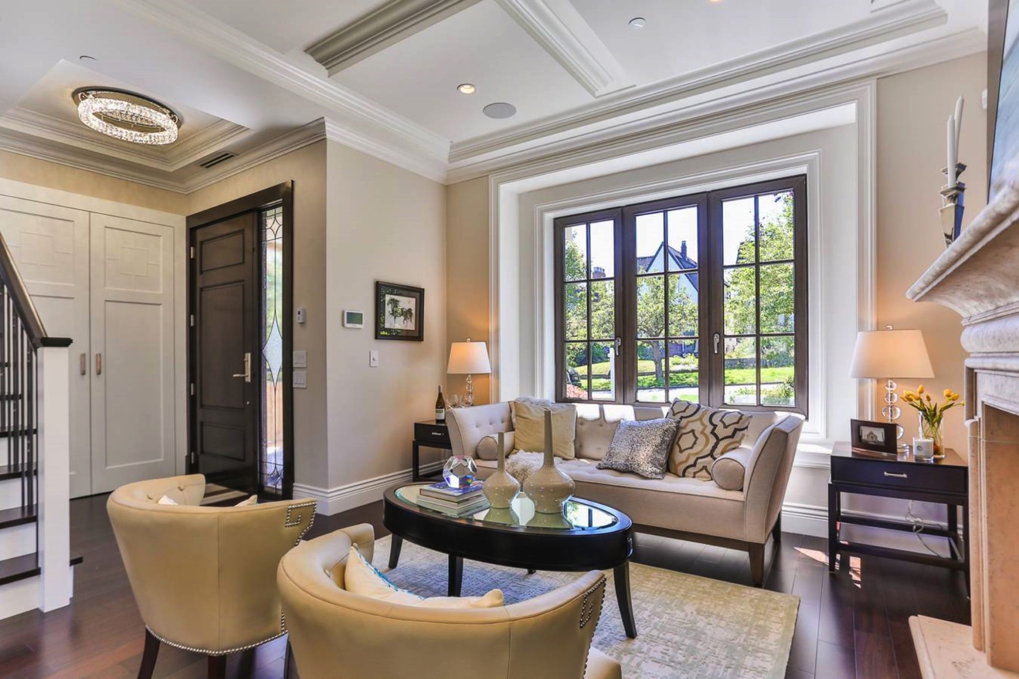 Sophisticated, comfortable living room with coffered ceiling by Enviable Designs