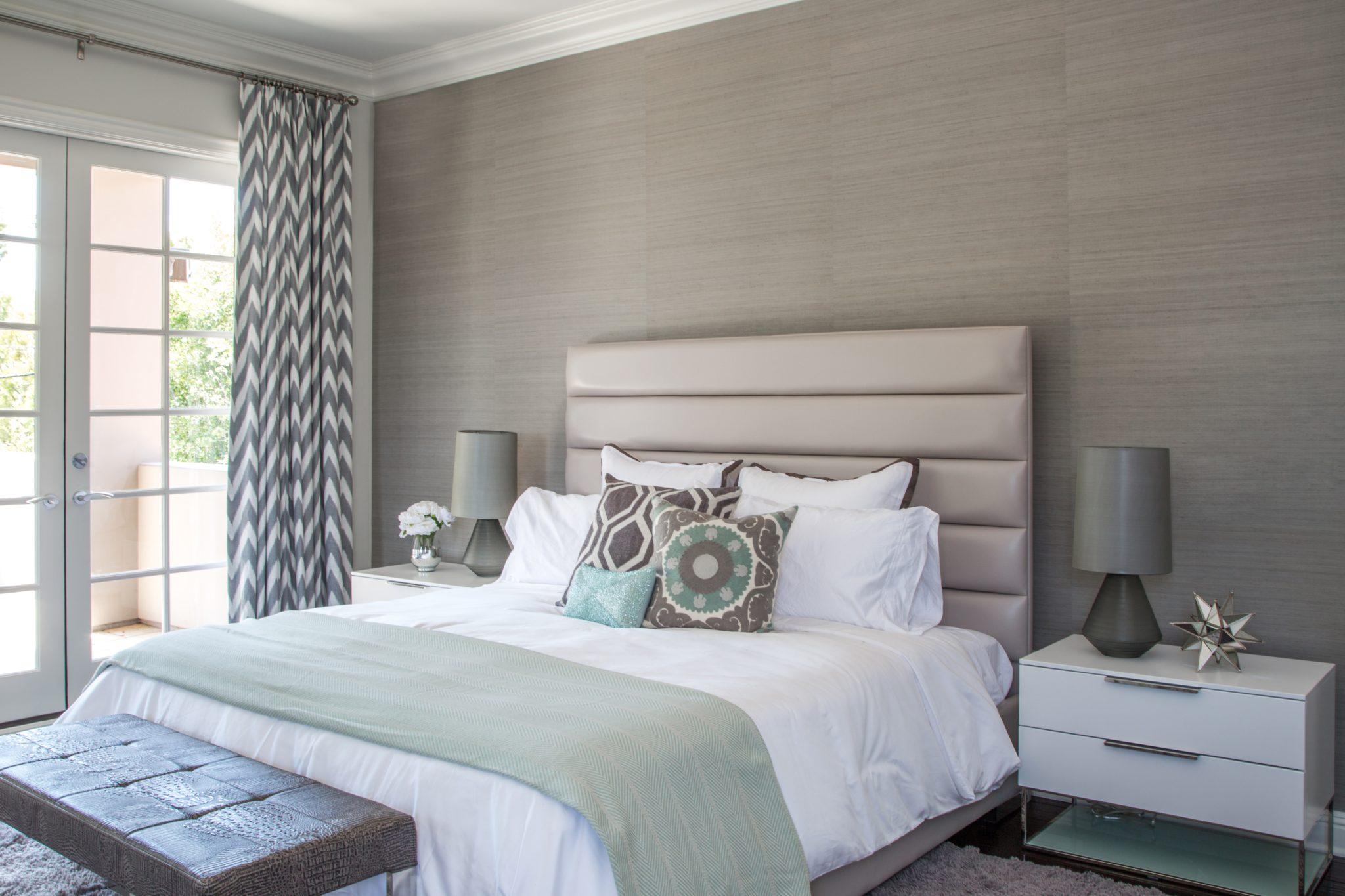 A serene master bedroom by dmar Interiors