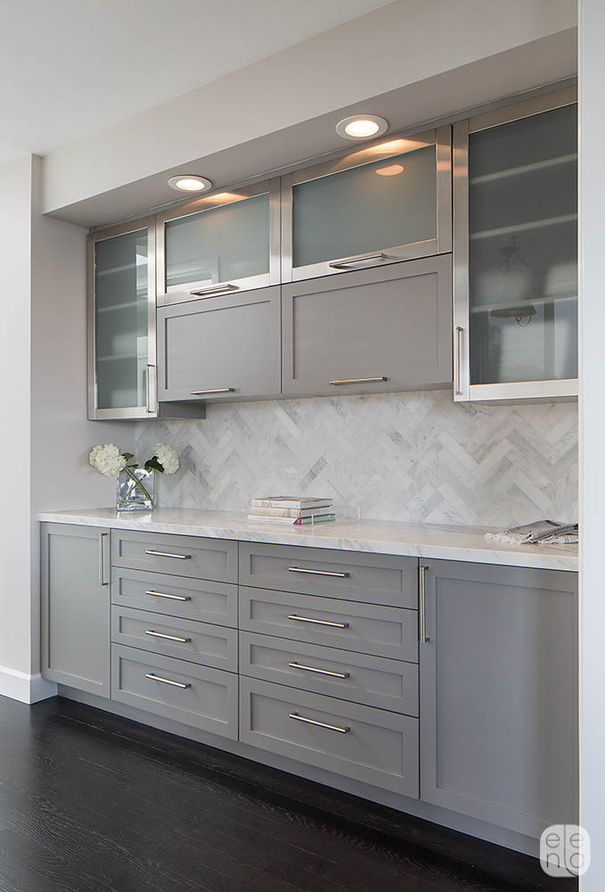 #9: Gray-toned kitchen with herringbone patterned marble tile backsplash and frosted glass and steel cabinets in Mill Valley, California, designed by Elena Calabrese. See more of the home here>