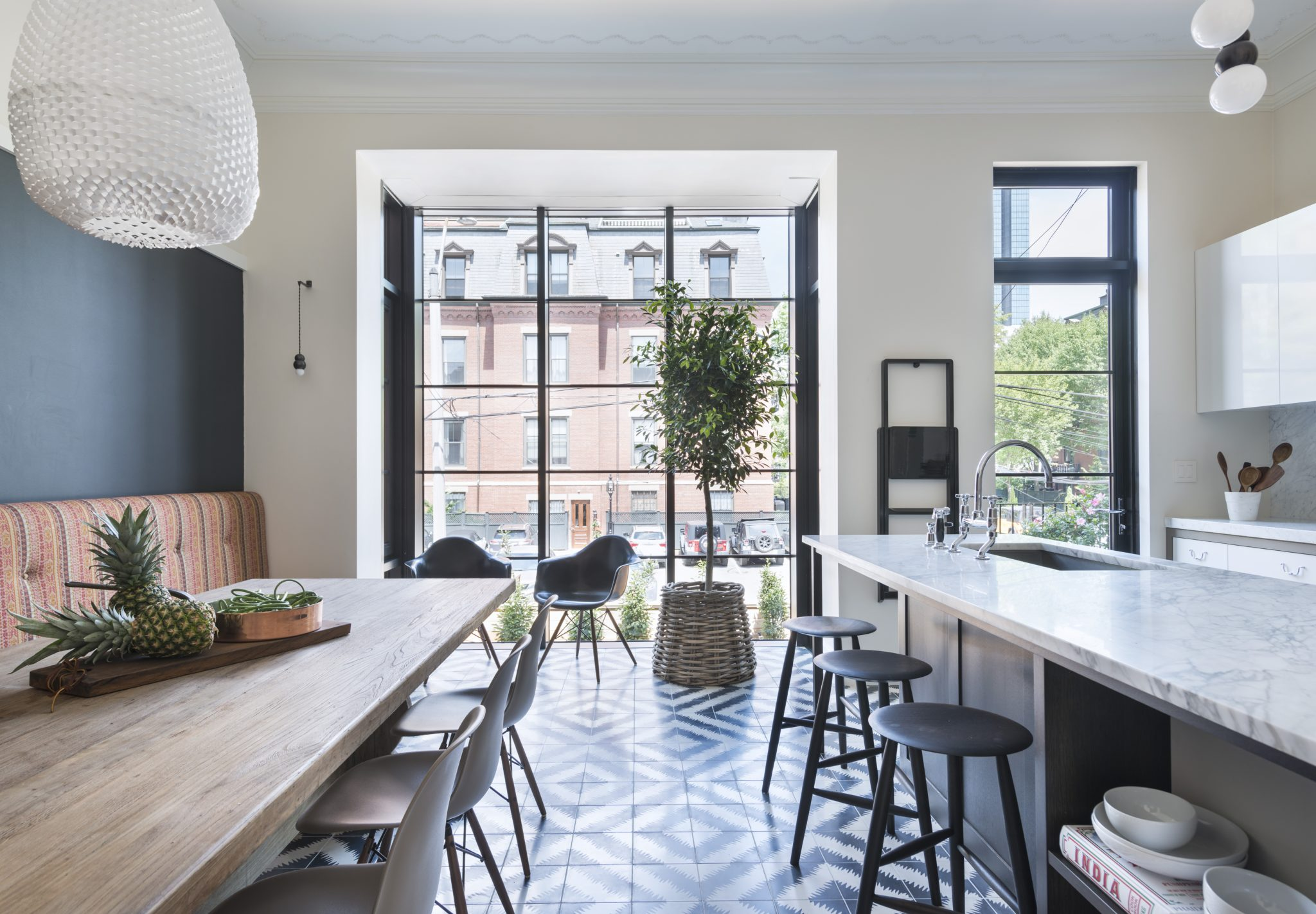 Urban townhouse kitchen with steel curtain window and cement floor by Koo de Kir Architectural Interiors