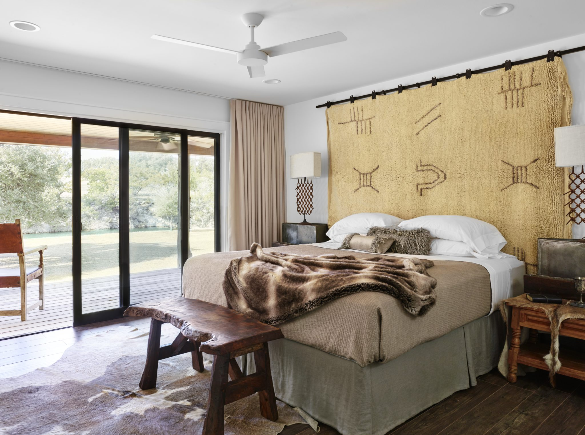 A rug from the High Atlas Mountains in Morocco makes a great headboard. by Marcus Mohon Interiors