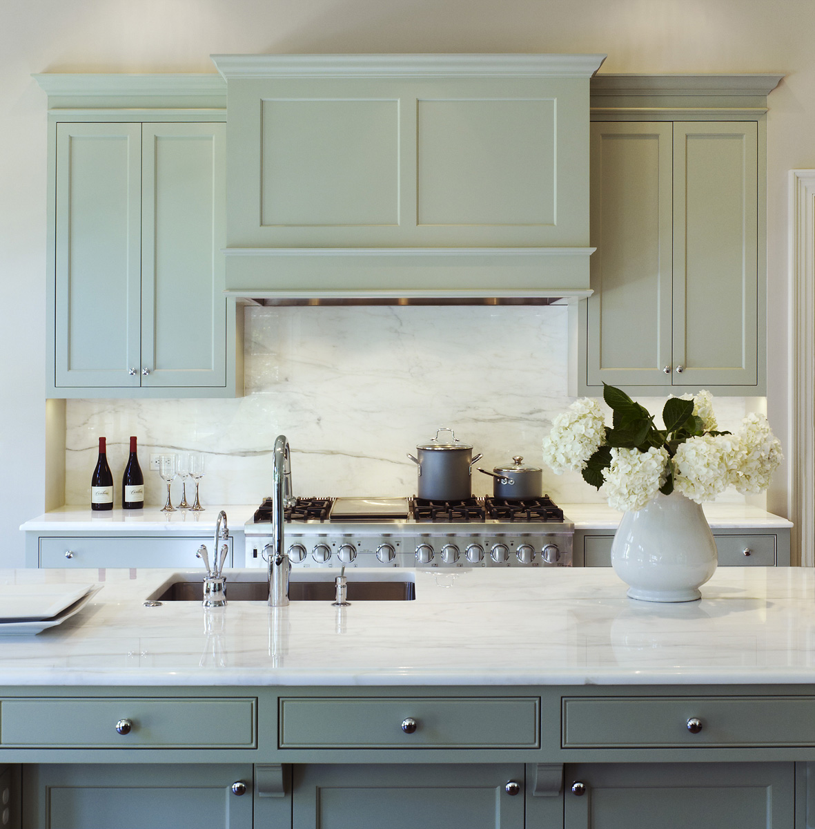 #8: Elegant kitchen with soft green colored cabinetry and crisp white countertop designed by Jones & Boer Architects, Inc. See more of the firm's work here>