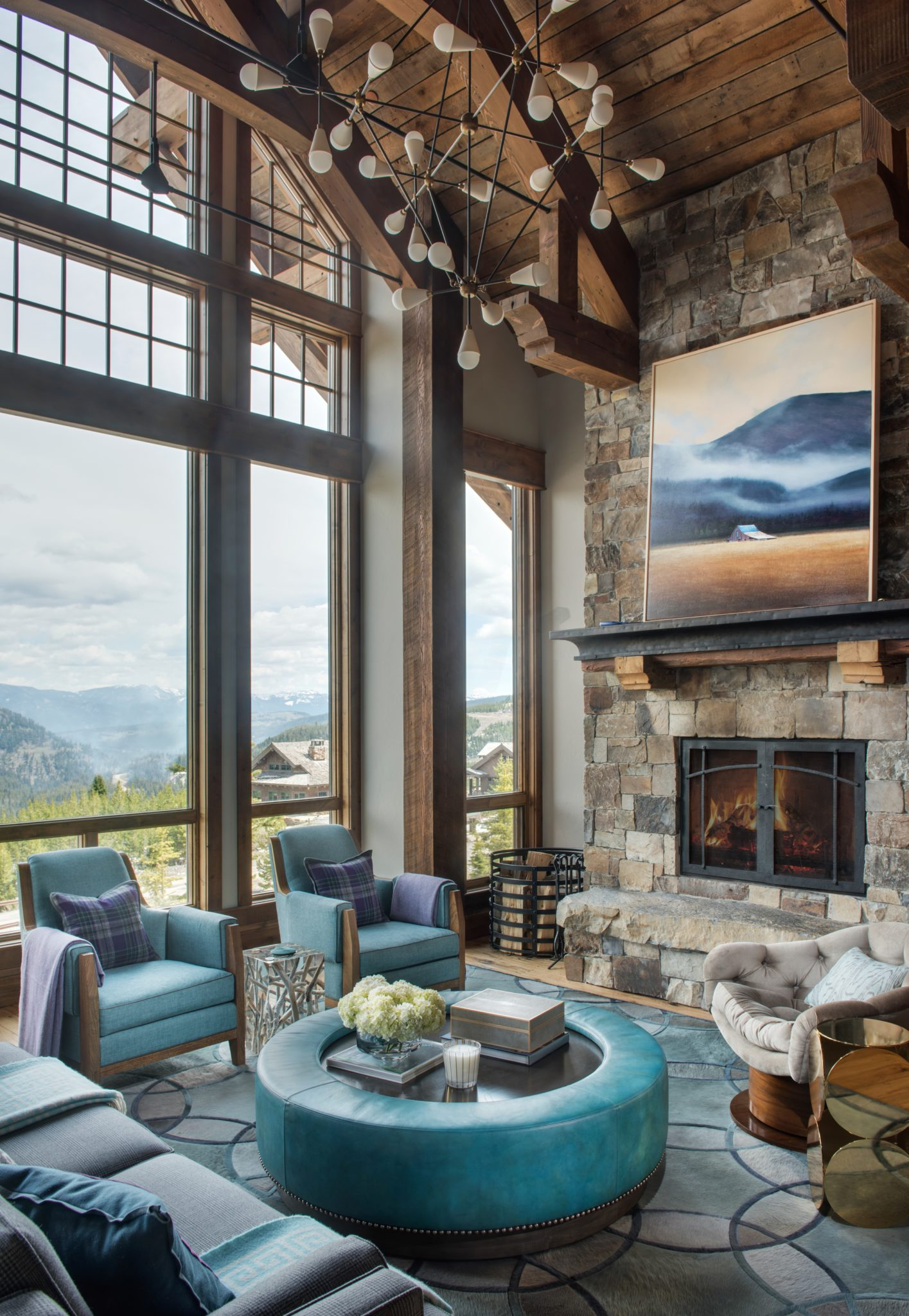 Montana Mountain Retreat Living Room with Large Picture Windows by Kelly Hohla Interiors