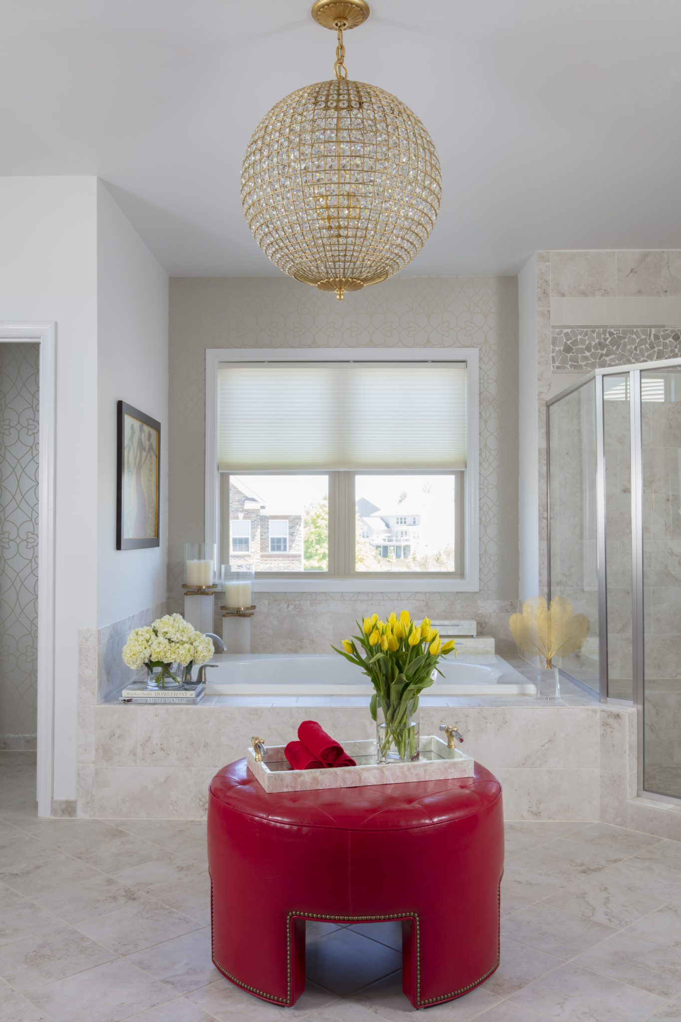 Master bath glamour momemt. Red accent. Shimmering chandelier. Neutral textures. by Paula Grace Designs – Signature Grace