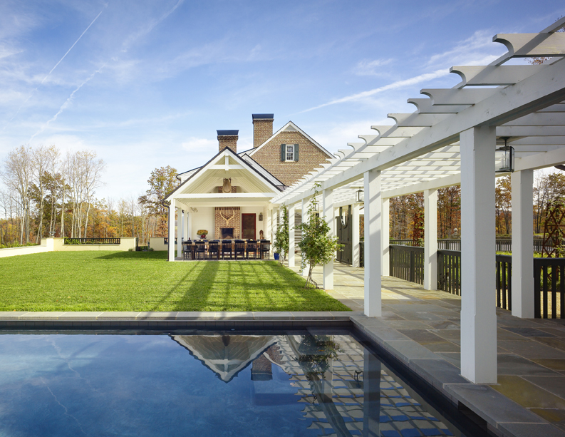 Weekend house in Virginia with outdoor dining room, fireplace, pool, pergola by Barnes Vanze Architects, Inc.