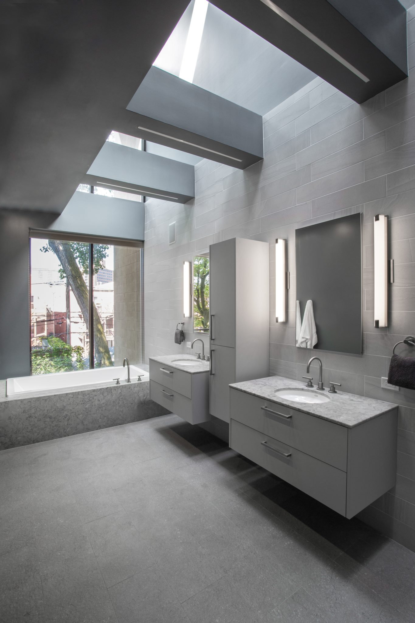 Luxury Old Town Chicago Modern Bathroom with large soaking tub by Nicholas Moriarty Interiors