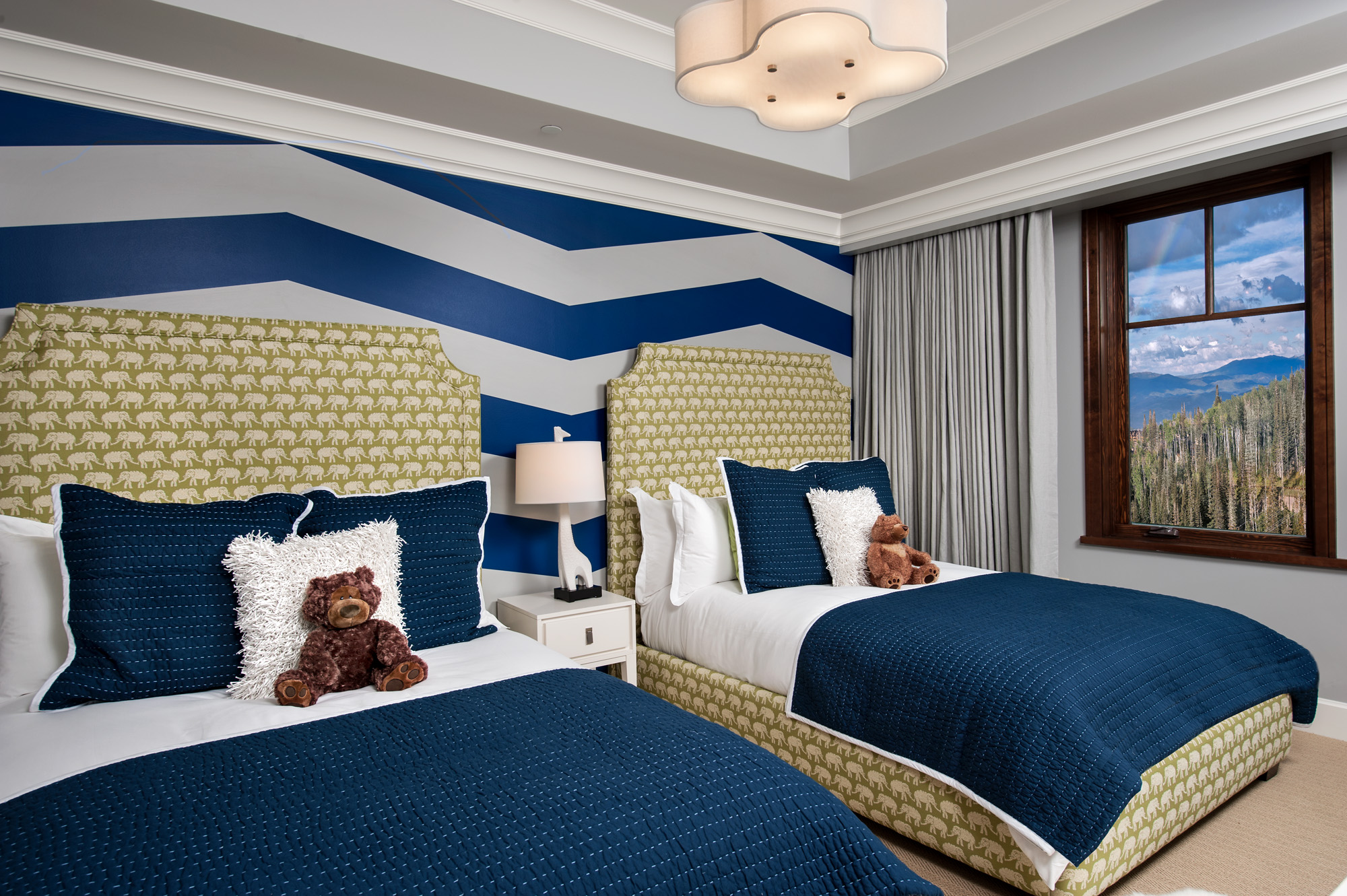 Navy & Green Kids Room with Chevron Accent Wall and Upholstered Beds by McBrien Interiors