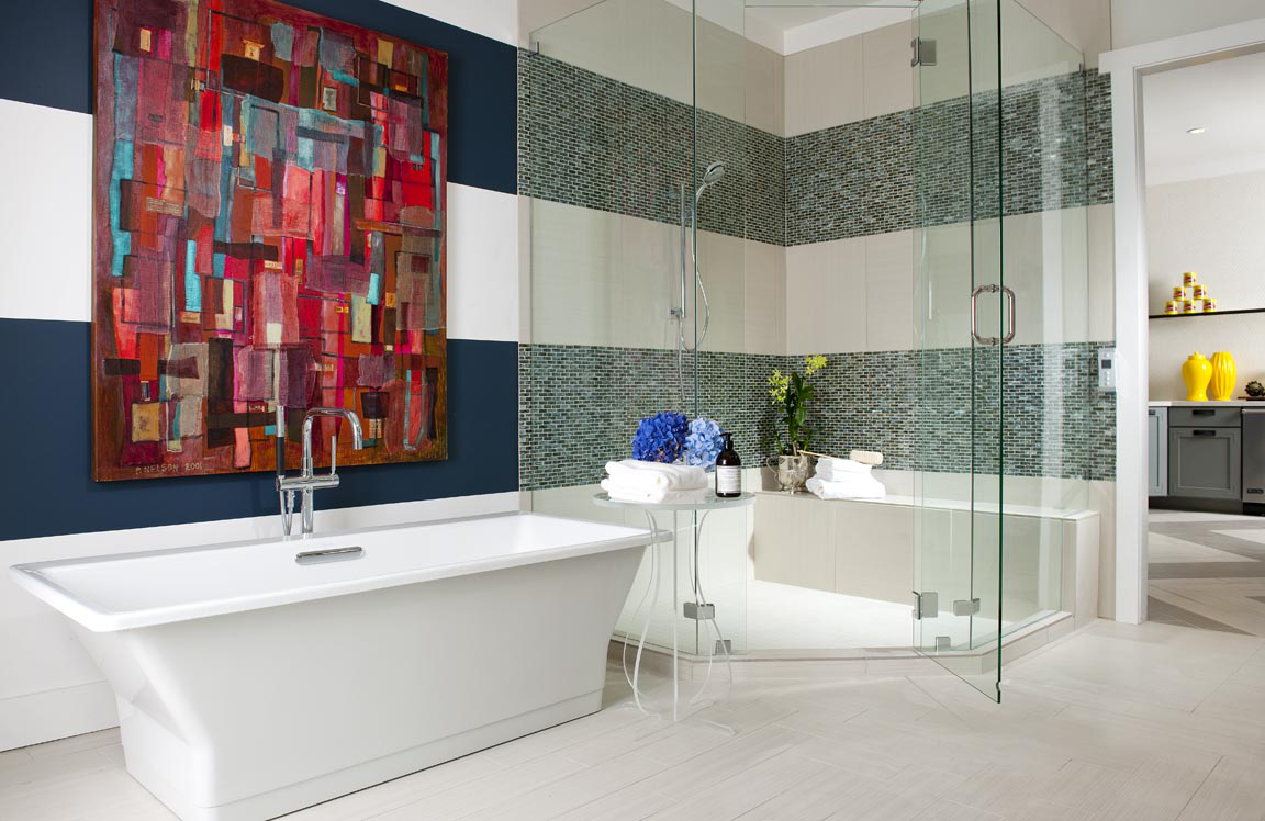 Bold, striped master bath with freestanding tub by Denise McGaha Interiors